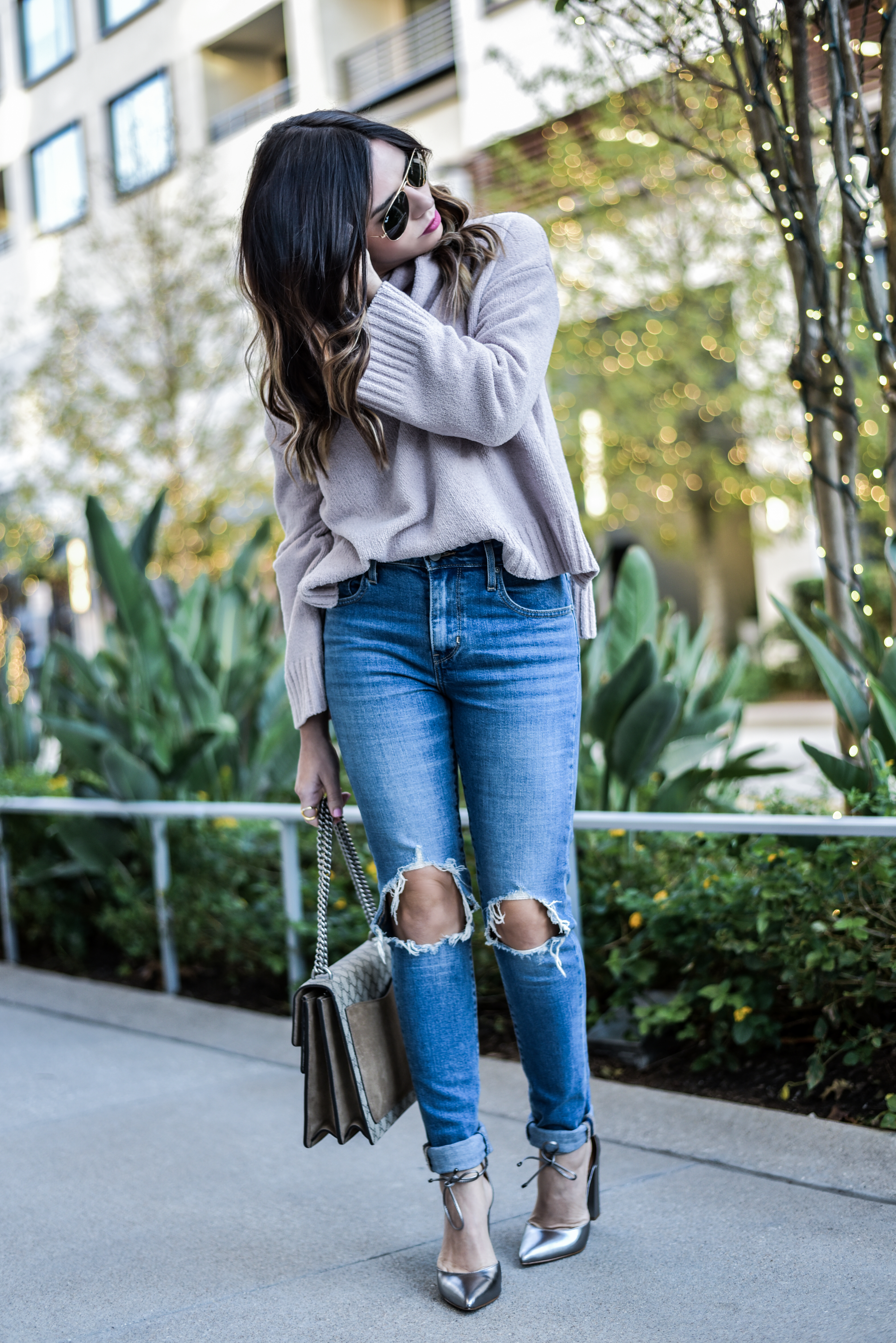 ripped skinny jeans styled with chunky knit sweater
