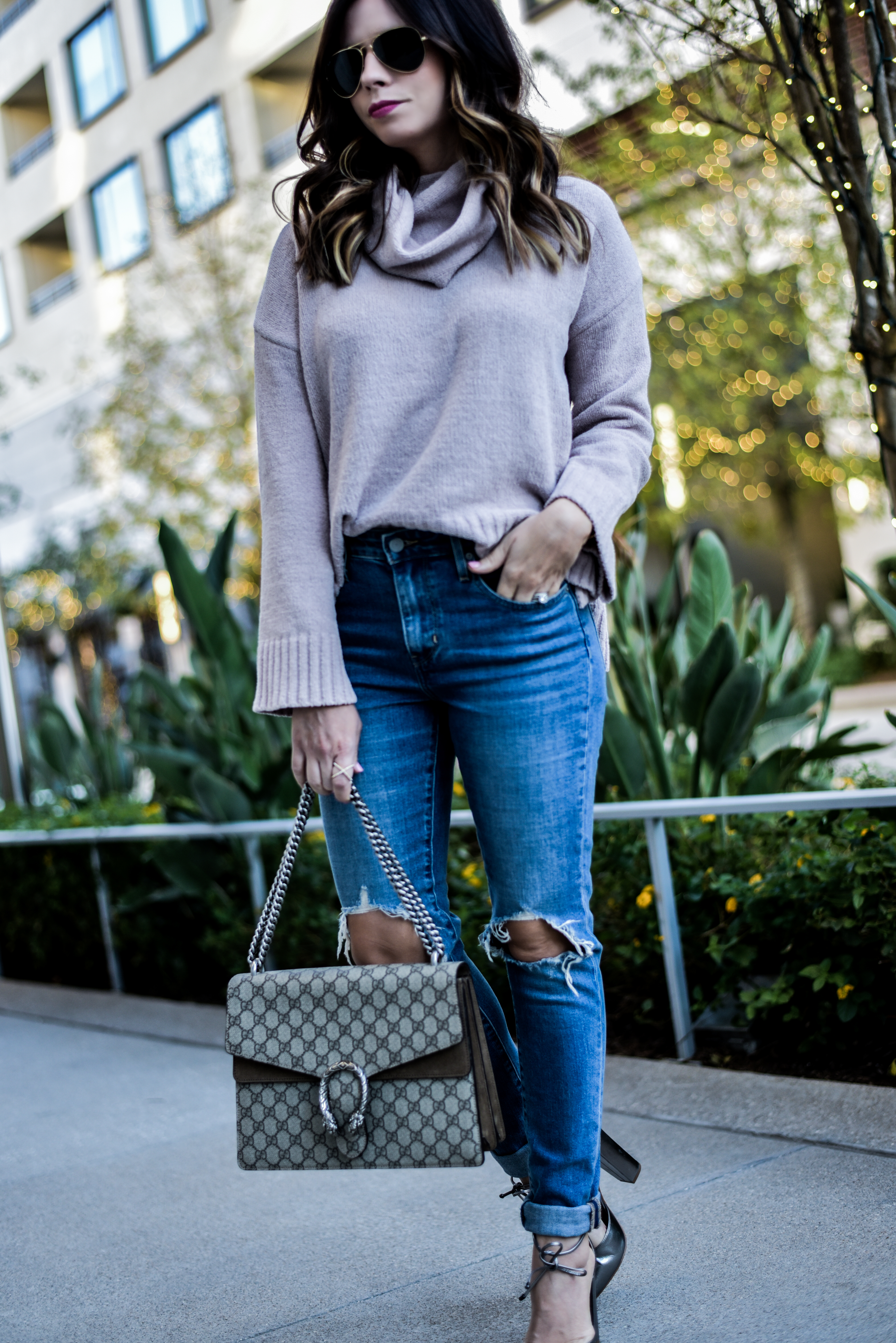 ripped skinny jeans with a BB Dakota sweater