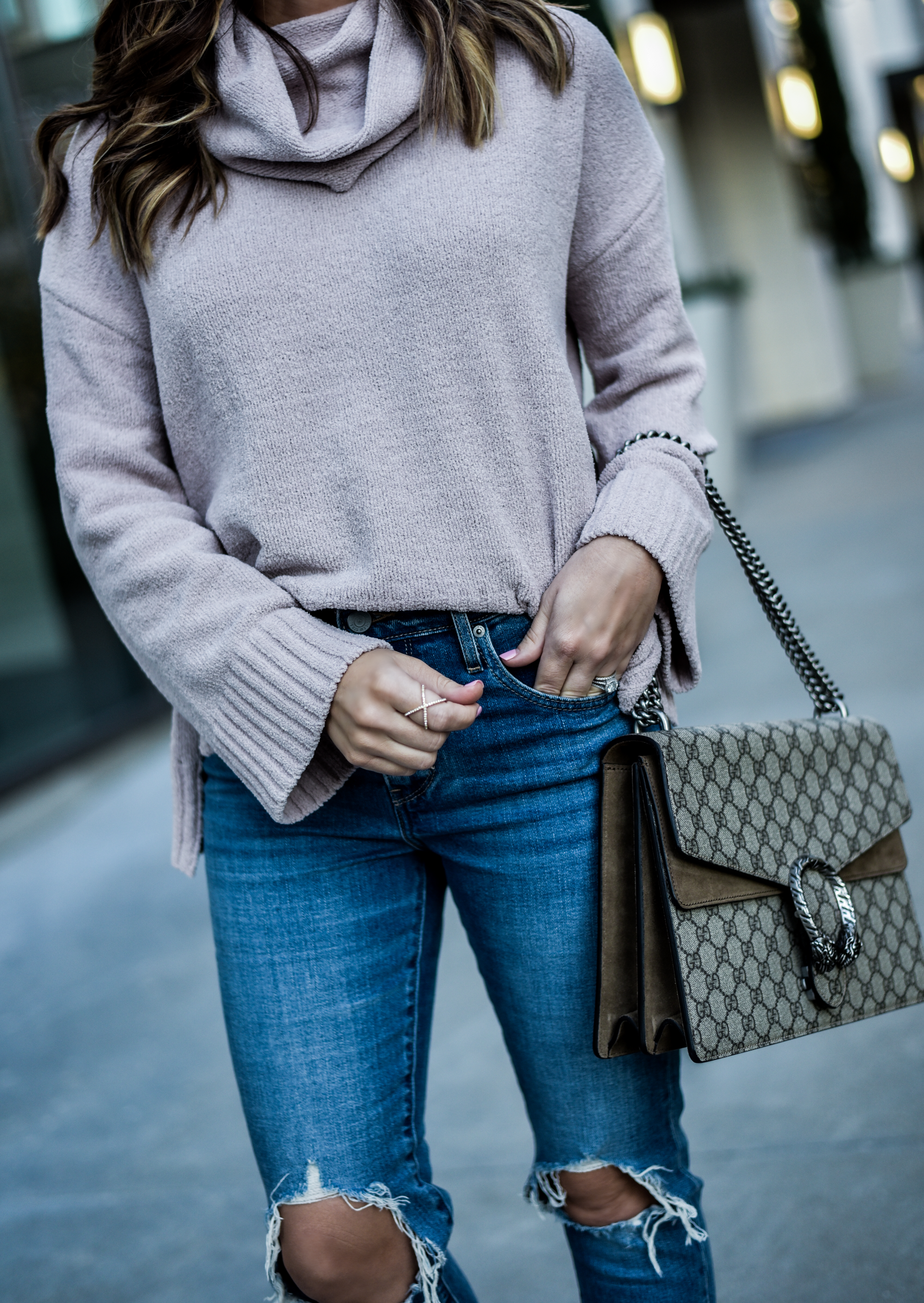 Chunky knit sweater and ripped levis |