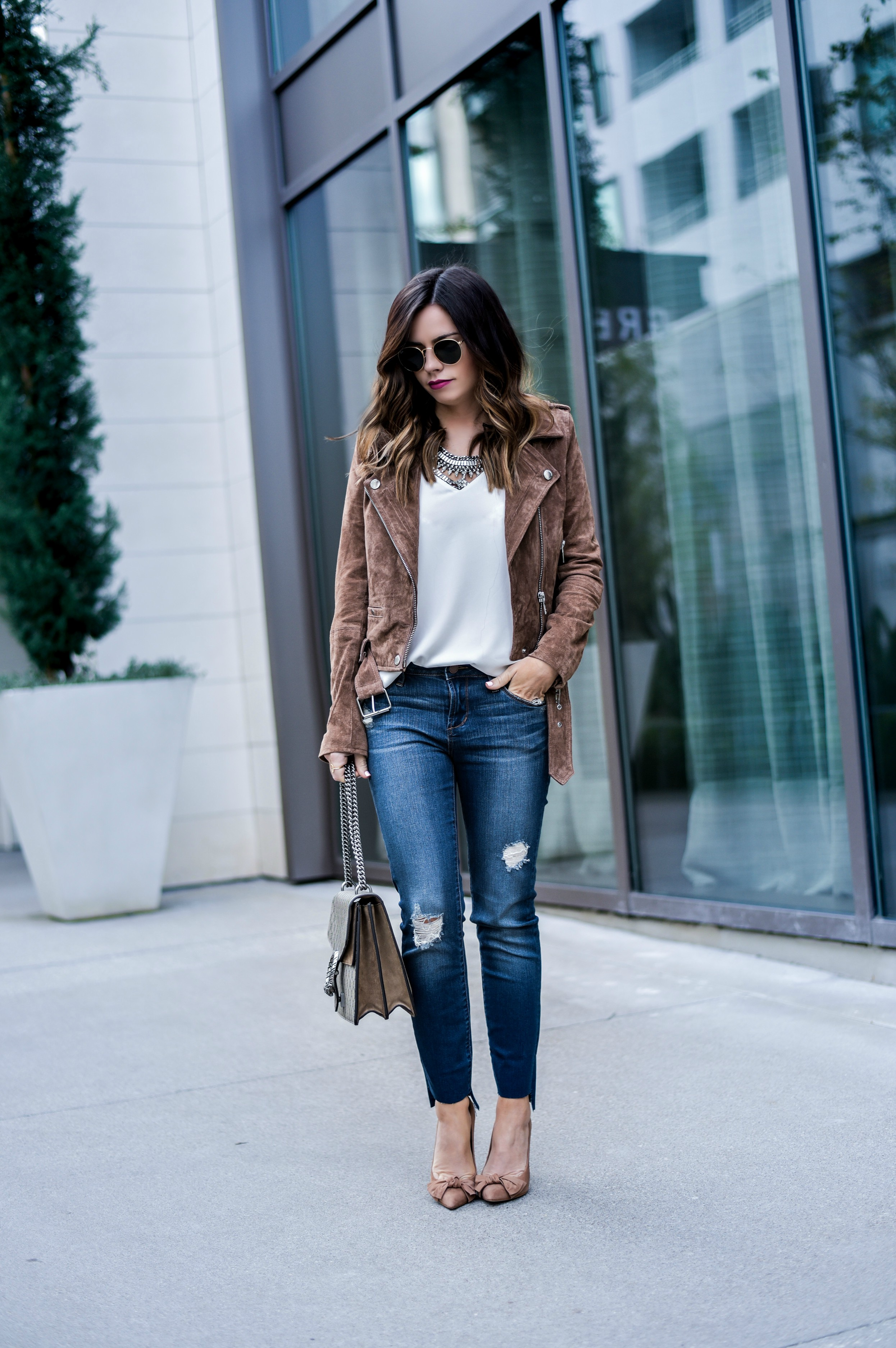 Style blogger Tiffany Jais of Flaunt and Center wearing a BLANKNYC moto jacket with Nordstrom jeans  