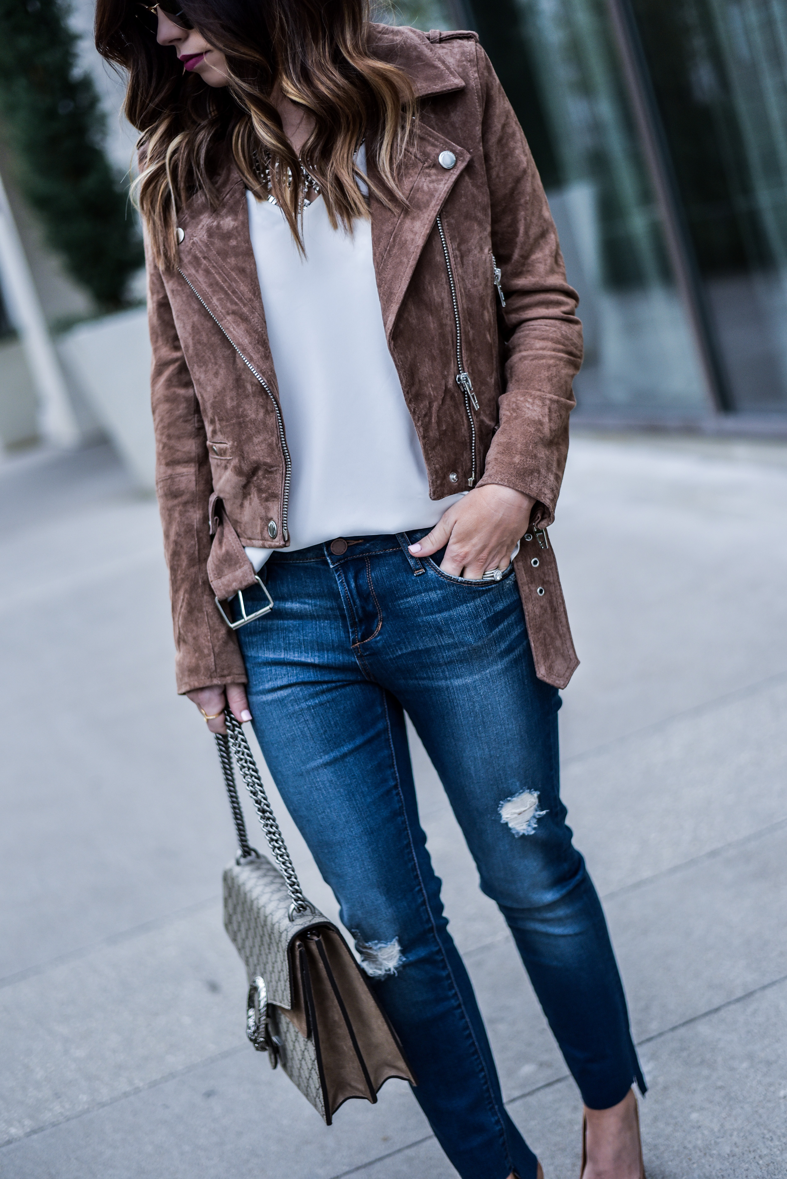 Style blogger Tiffany Jais of Flaunt and Center wearing a BLANKNYC suede moto jacket with Nordstrom jeans  