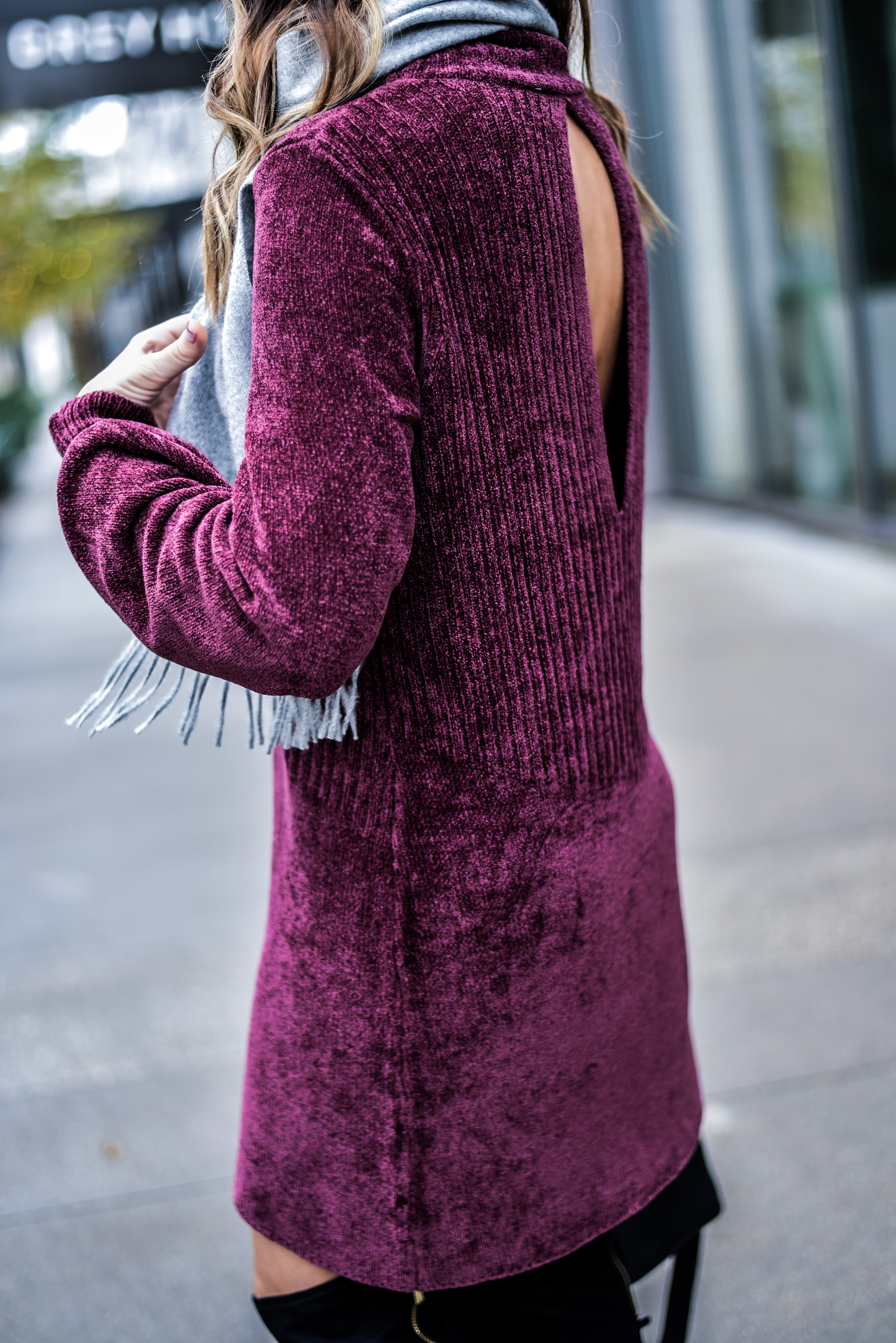 Houston style blogger Tiffany Jais wearing a Free People dress with black over the knee boots and a fringe scarf.