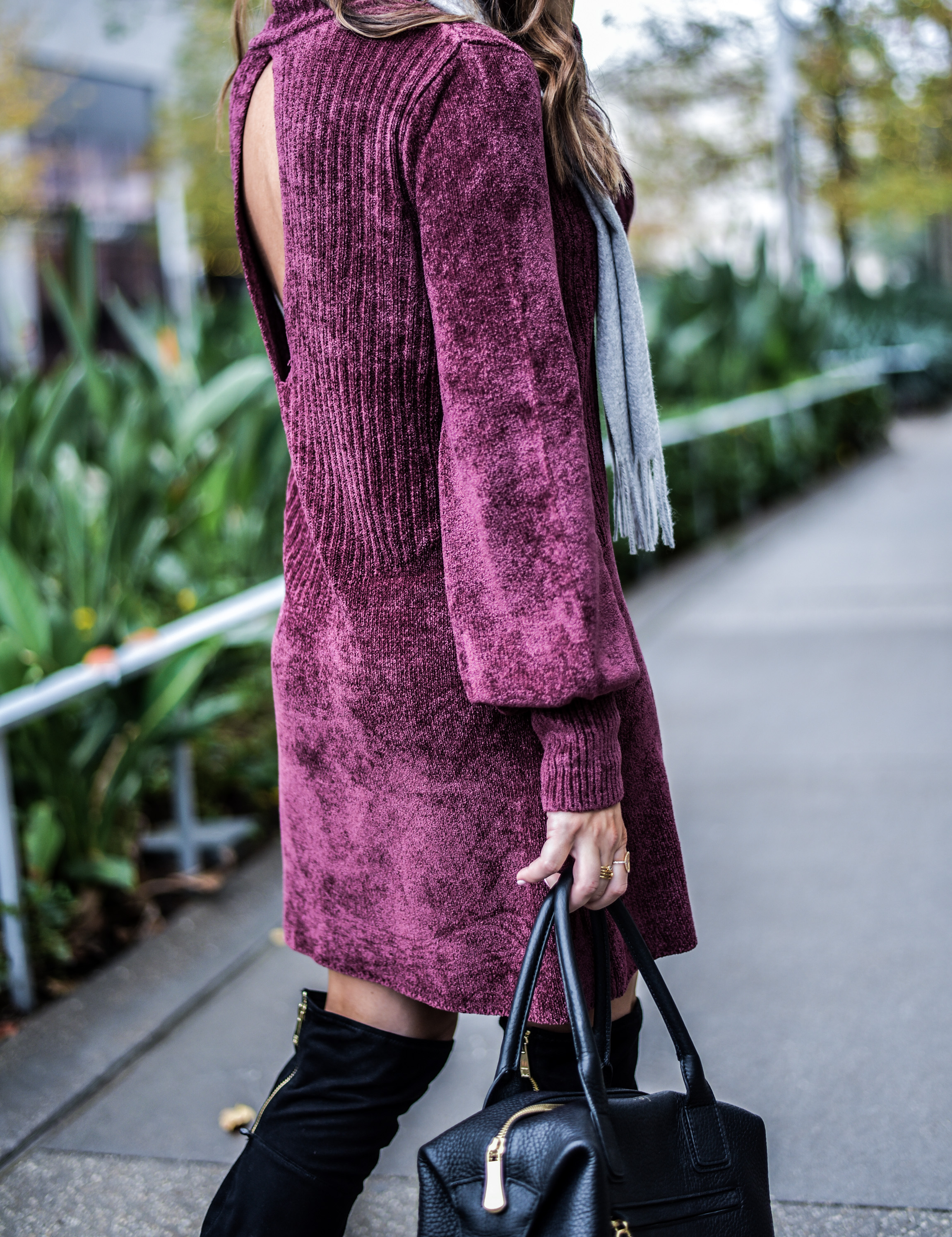 Houston fashion and style blogger Tiffany Jais wearing a Free People sweater dress and black over the knee boots | women's fashion