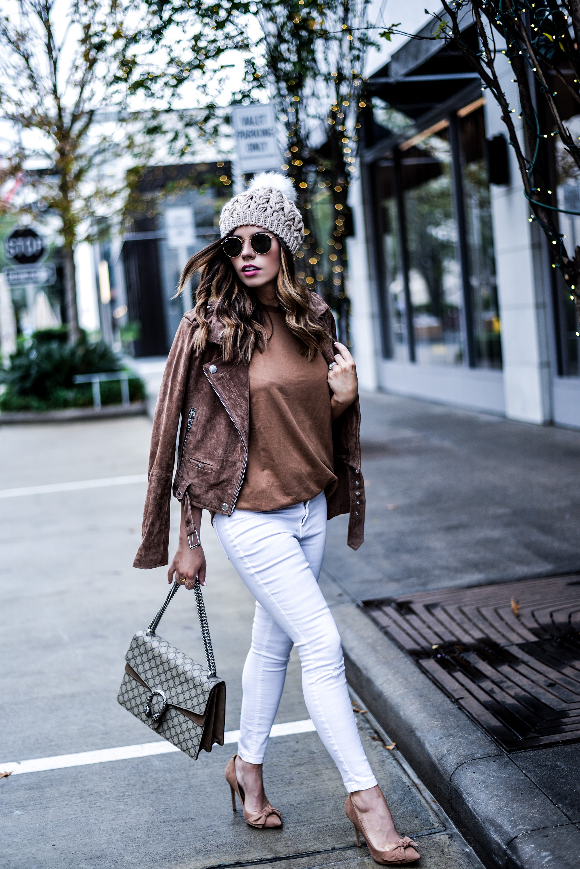 Tiffany Jais the Houston Style blogger of Flaunt and Center wearing caramel hues, a Blank NYC suede moto jacket with an ASOS top, steve madden token heels, white skinny jeans, and a Gucci Dionysus bag | what's trending in women's fashion