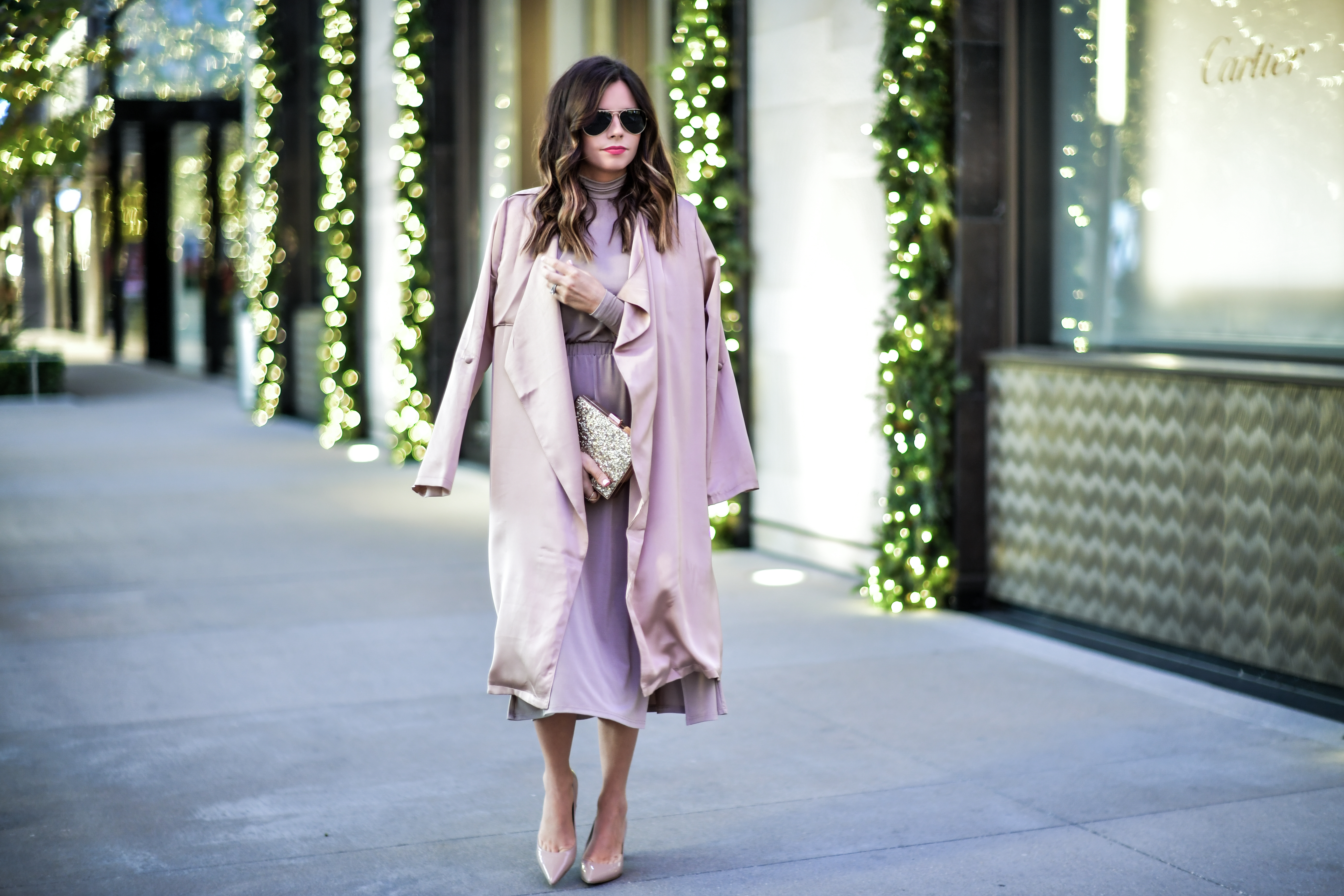 Fashion blogger Tiffany Jais of Flaunt and Center is wearing a cutout dress by ASOS and a sparkle clutch for a chic Holiday look