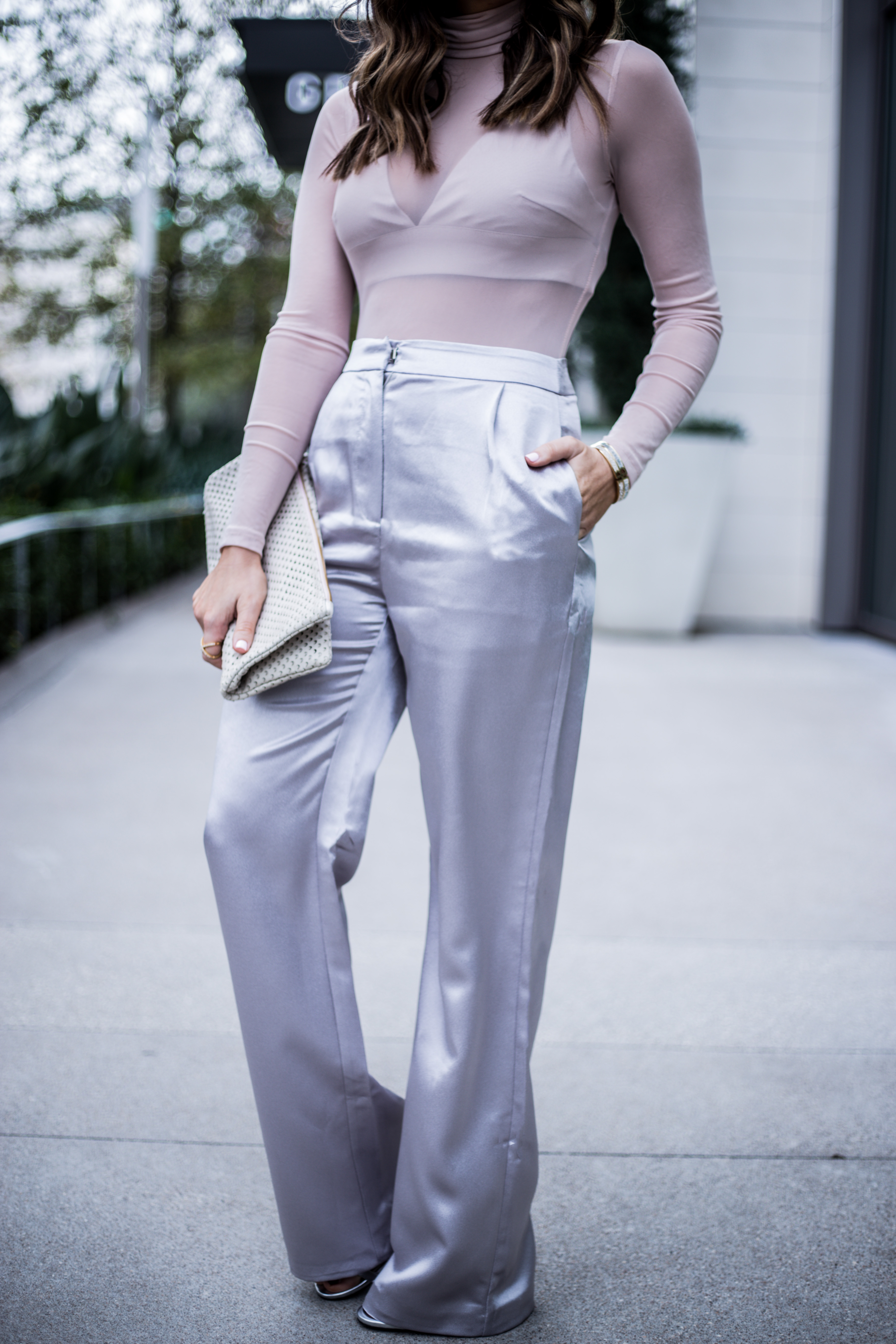 Loving how great these satin silver pants go with this sheer top |