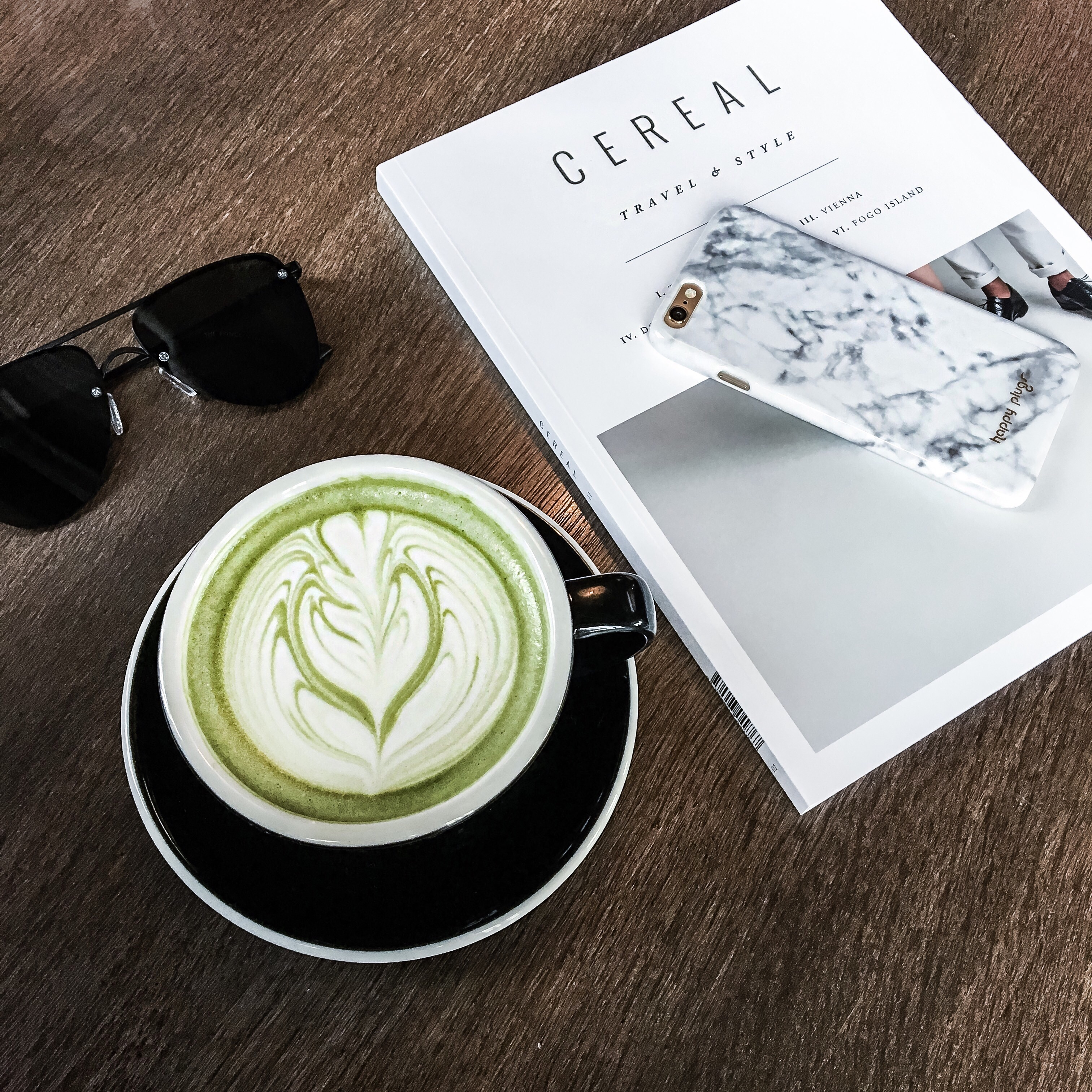 Houston Style blogger Tiffany Jais and the writer of the Fashion blog Flaunt and Center daily inspo via Instagram   Cereal magazine, green tea latte, and a white marble phone case