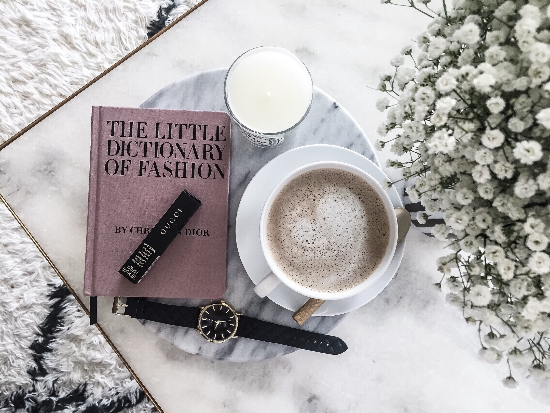 Houston style blogger Tiffany jais   The little dictionary of fashion book and a round marble serving tray