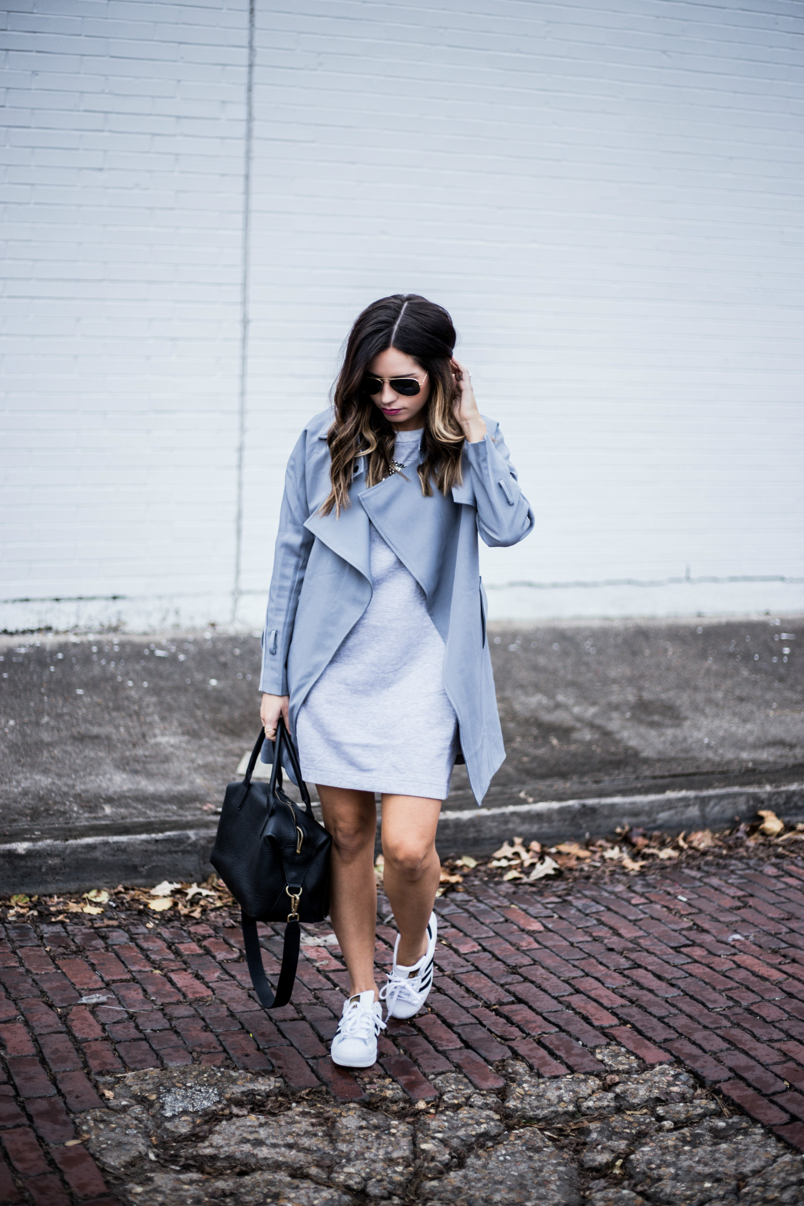 Grey trench coat with a light grey dress and sneakers | what's trending in fashion 2016