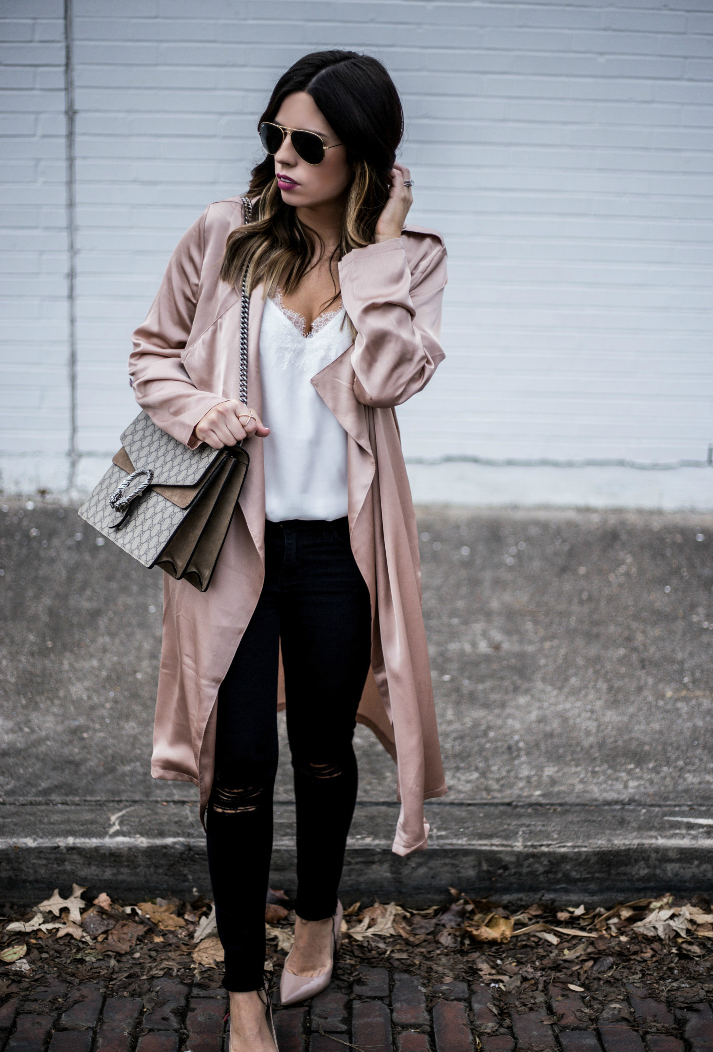 Satin blush duster paired with black distressed skinny jeans | what's currently trending in women's fashion 2016
