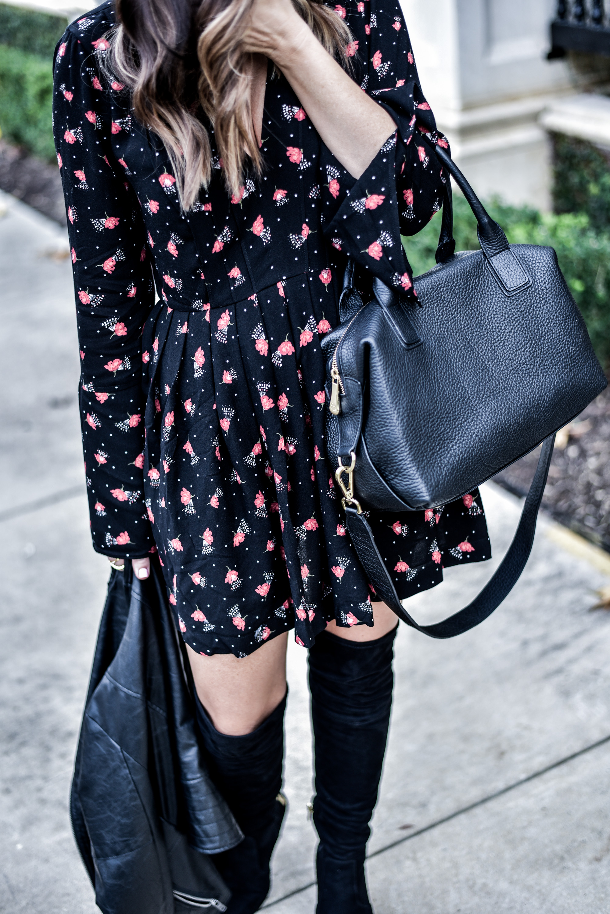 Tiffany Jais, Houston style blogger and writer of the fashion blog Flaunt and Center wearing a floral printed mini dress by Free People