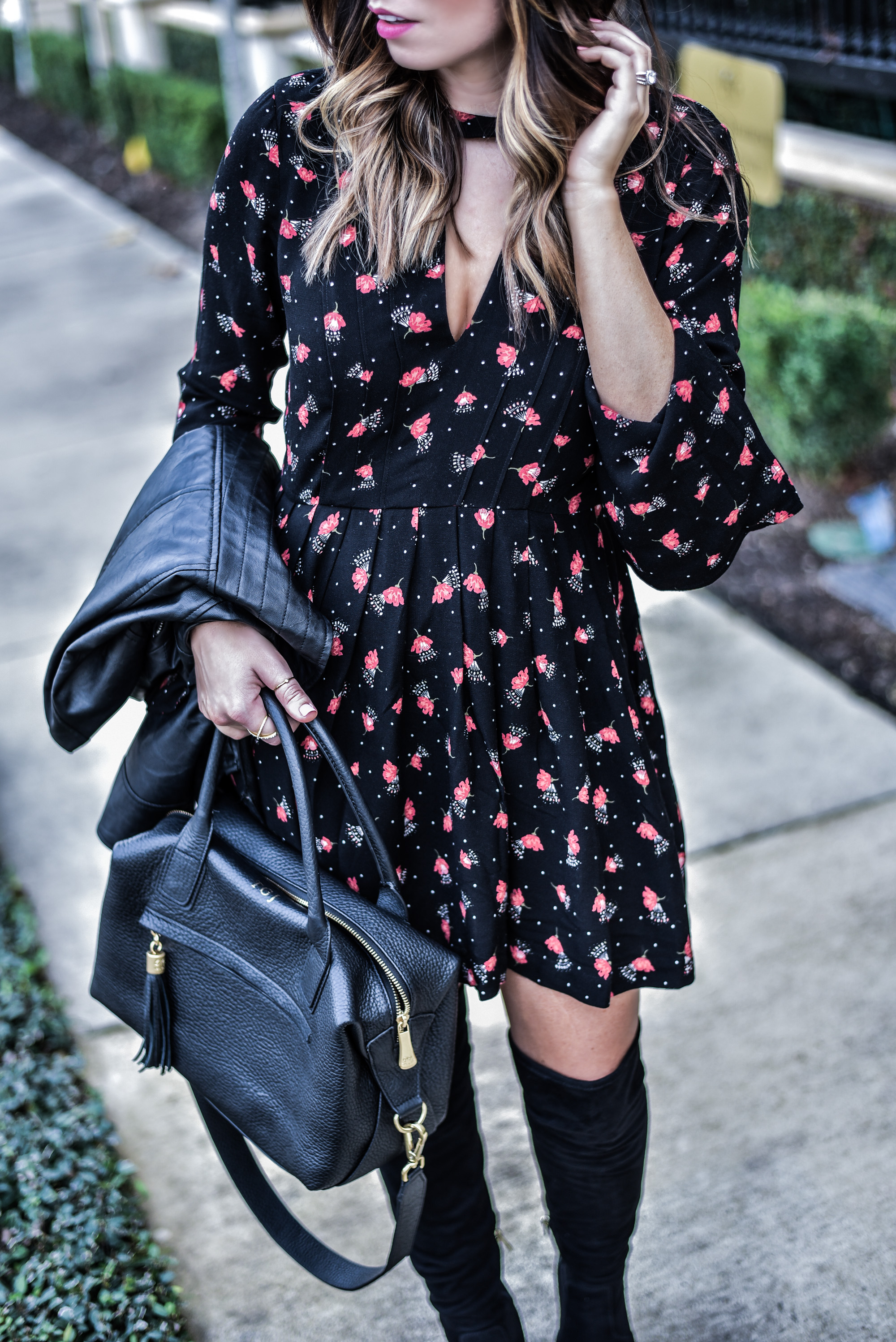Tiffany Jais, Houston style blogger and writer of the fashion blog Flaunt and Center wearing a floral printed mini dress by Free People and black Ivanka Trump over the knee boots
