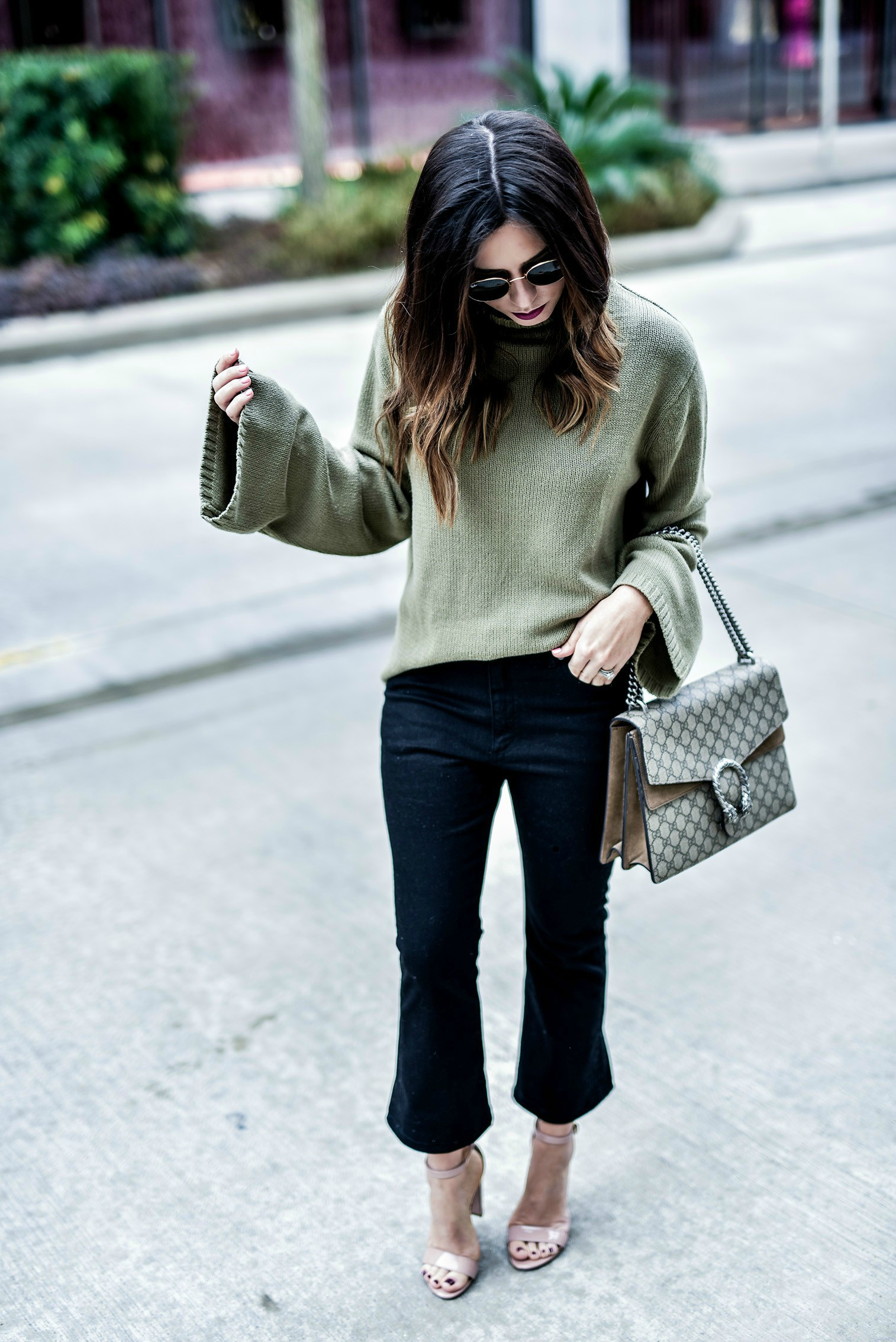 Tiffany Jais Houston fashion and lifestyle blogger Wearing a bell sleeve sweater in olive, and black denim flare cropped jeans | Gucci Dionysus bag, what's trending