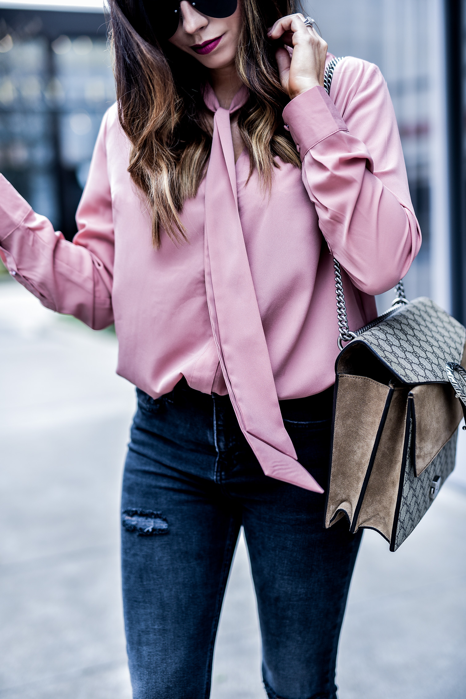 Tiffany Jais Houston fashion and lifestyle blogger sharing a blush neck-tie blouse paired with a gucci Dionysus bag, and dark grey distressed skinny jeans. Click to read more | Streetstyle, fashionista