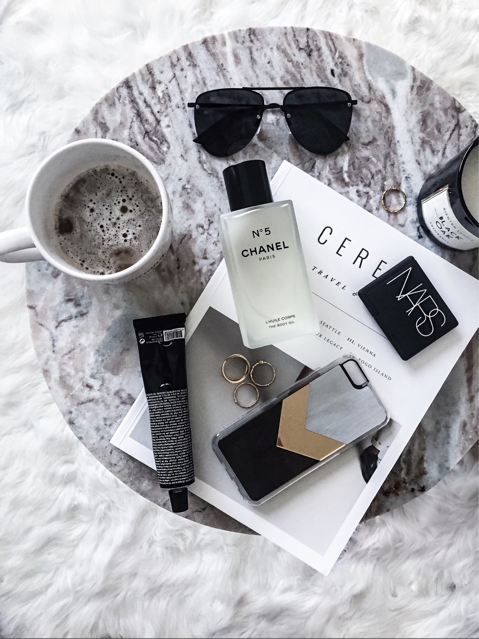 Click here to read about Houston fashion blogger Tiffany Jais   Cereal magazine, Le Spec Sunglasses   Coffee, Grown Alchemist hand cream, zero gravity iPhone case