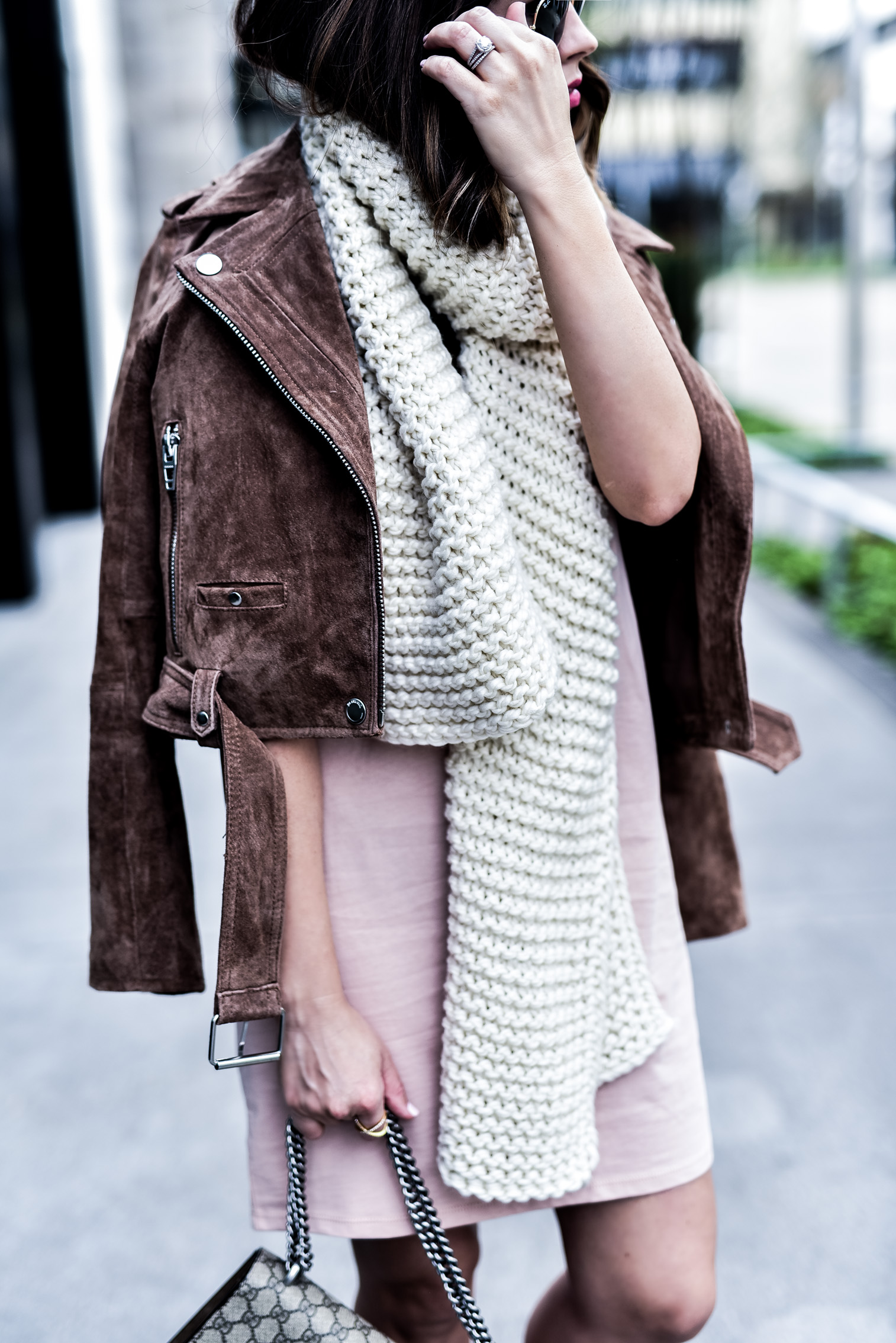 Houston fashion blogger wearing an asos pink t-shirt dress and a blank nyc suede moto jacket, read up on how to concur effortless casual style by clicking this photo | Gucci Dionysus bag, chunky knit scarf, sneakers and a dress