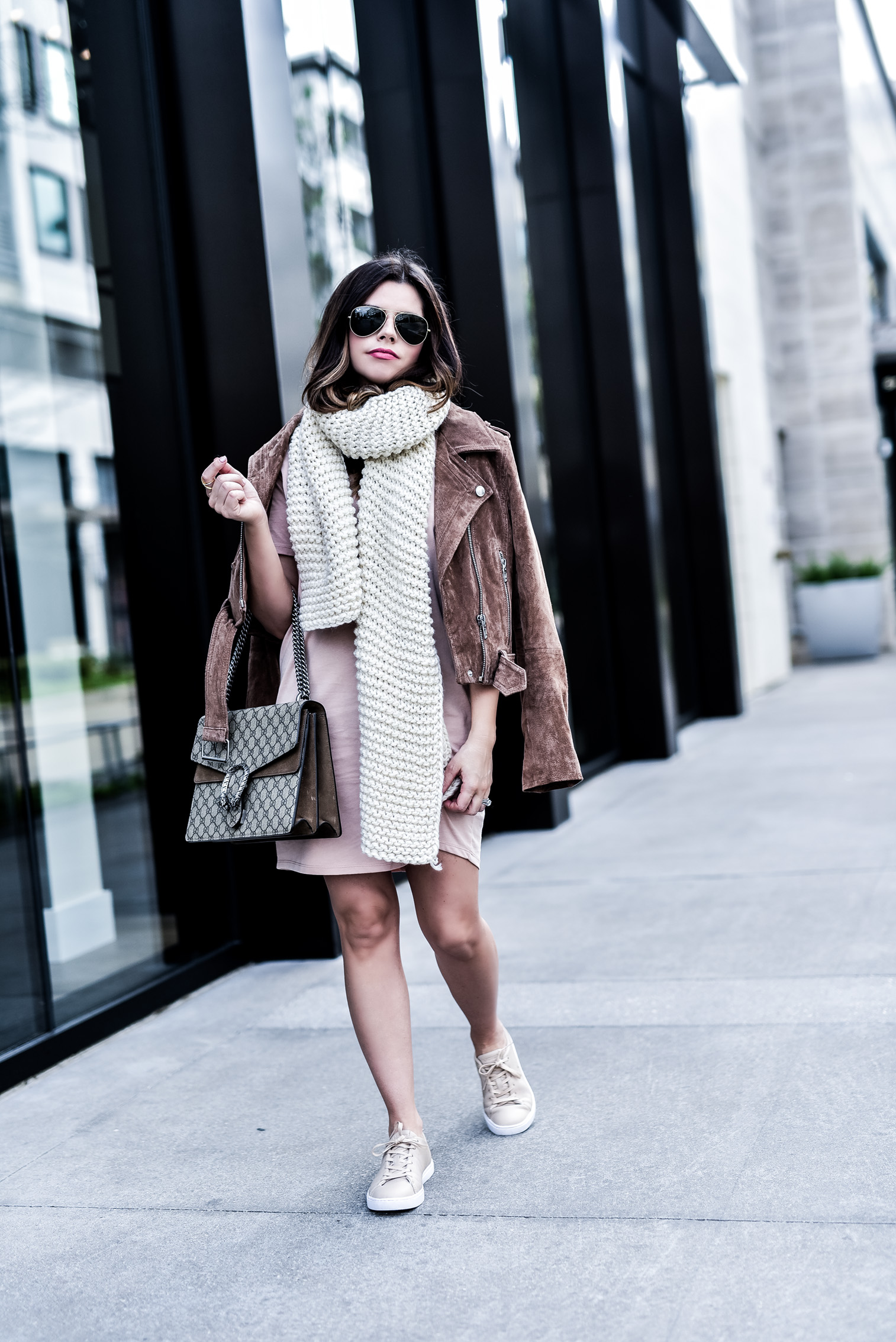 Houston fashion blogger wearing an asos pink t-shirt dress and a blank nyc suede moto jacket, read up on how to concur effortless streetstyle by clicking this photo  