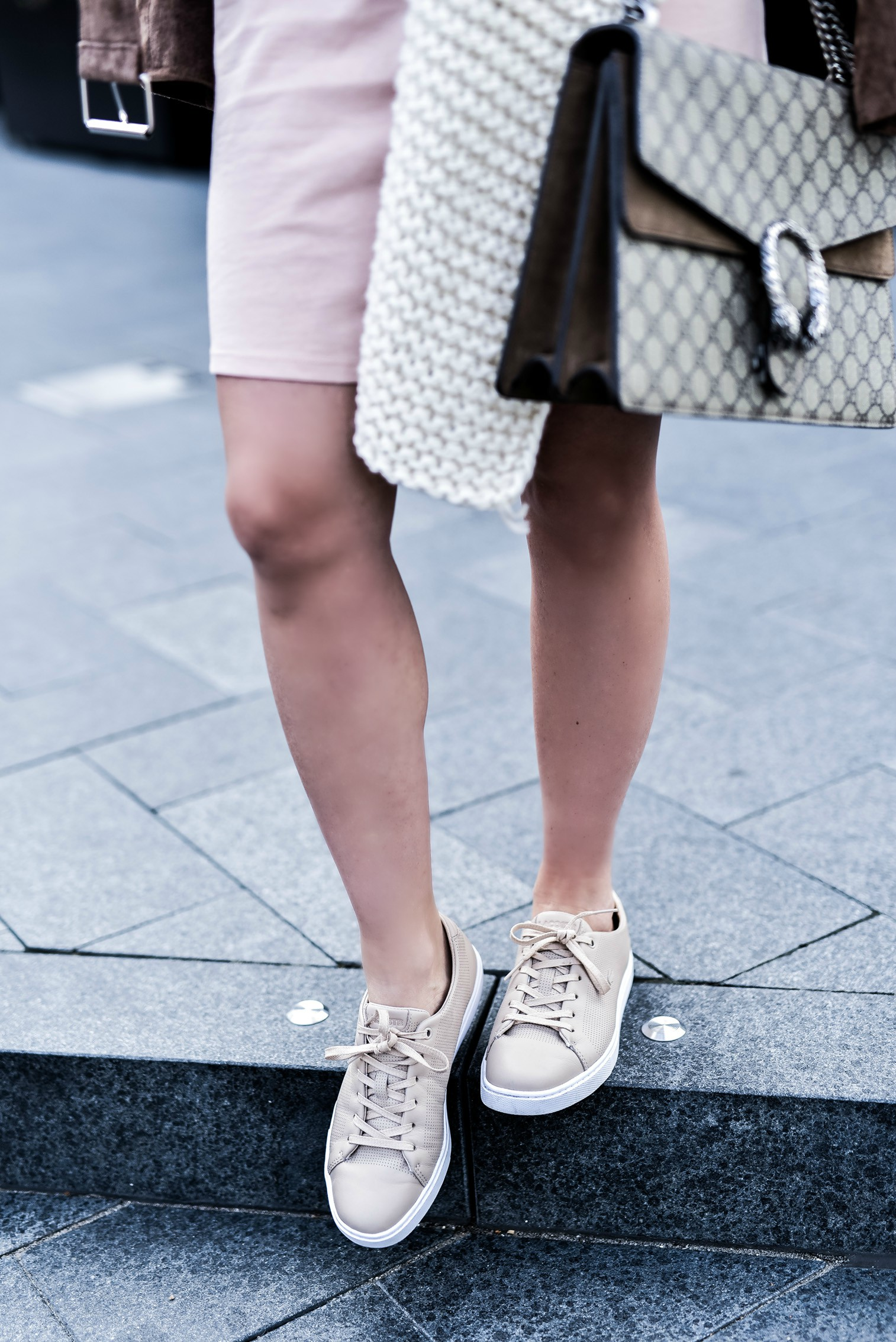 Houston fashion blogger wearing an asos pink dress and a blank nyc suede moto jacket, read up on how to concur effortless casual style by clicking this photo   Gucci Dionysus bag, chunky knit scarf, Lacoste sneakers and a dress