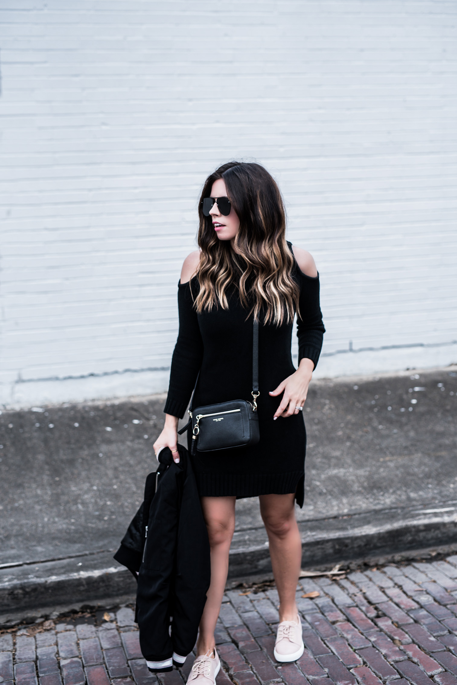 Houston fashion blogger wearing a cold shoulder sweater dress by Revolve, and a neutral sneaker by Elaine Turner, click to shop the look | Outfit ideas for spring, bomber jacket, blogger style, fashionista, best casual outfits