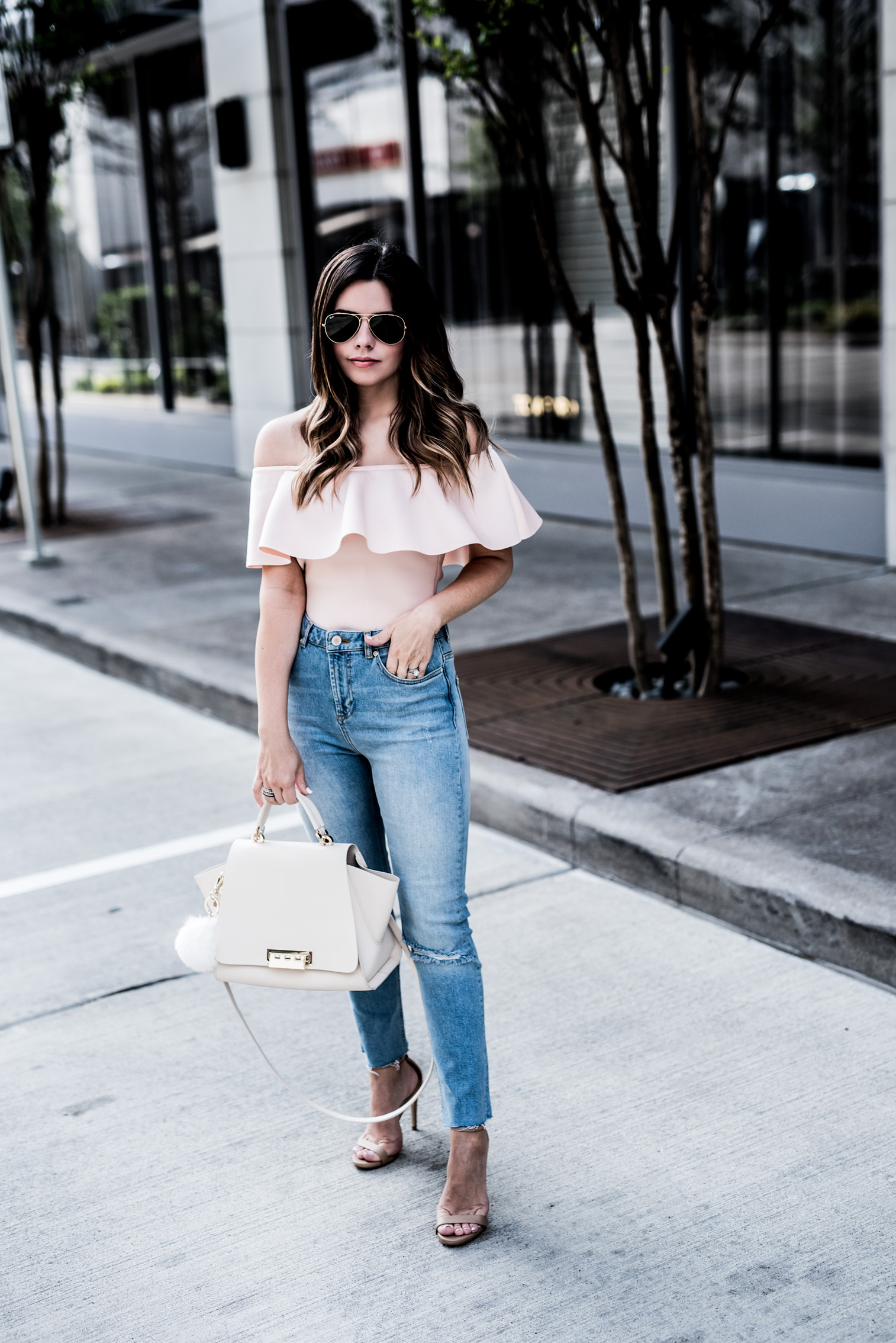 Tiffany Jais Houston fashion and lifestyle blogger wearing a blush off the shoulder ruffle top and high waisted denim jeans for petites, click to shop the post | outfit ideas for spring, streetstyle 2017