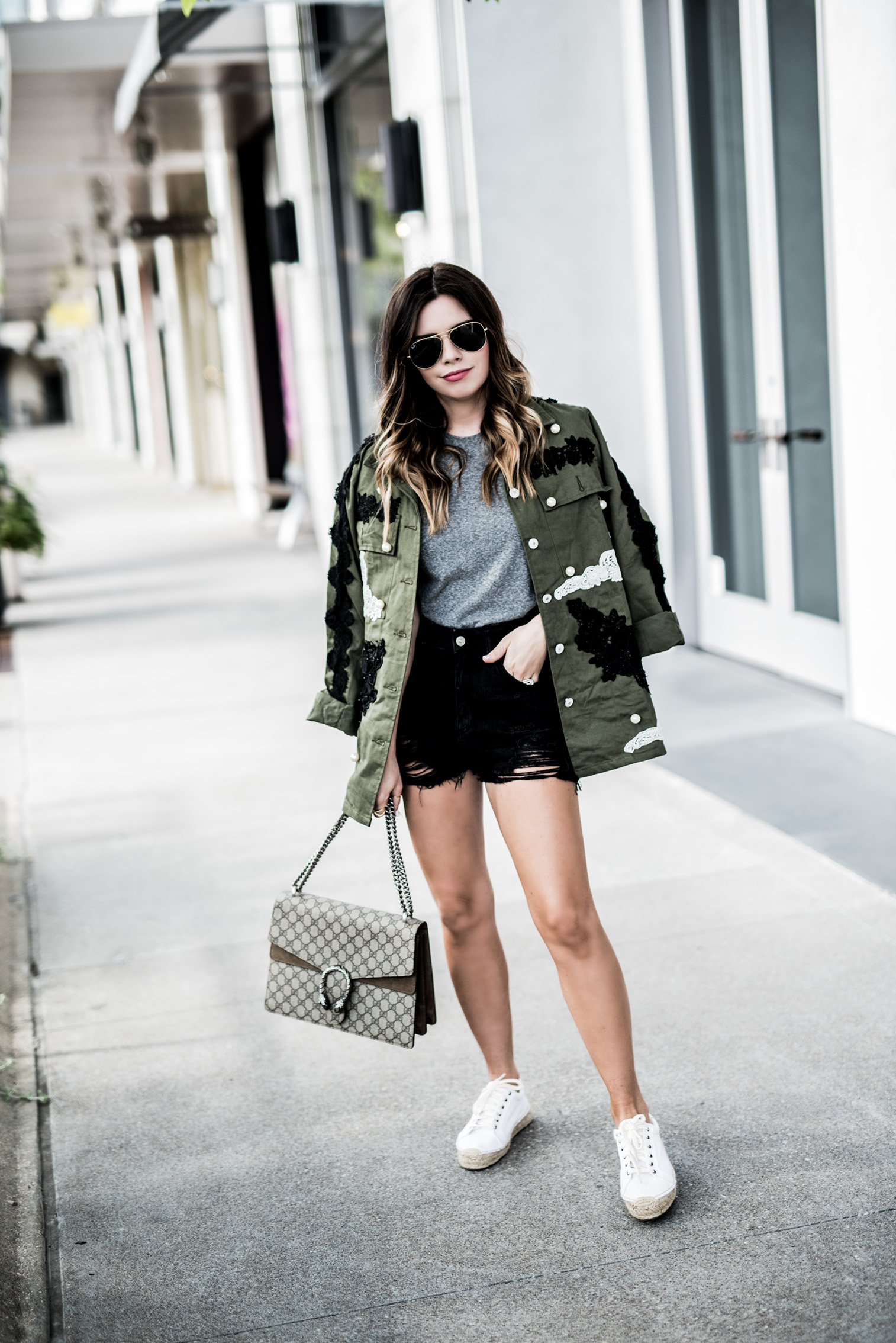 Tiffany Jais Houston fashion and lifestyle blogger | How to wear this springs embellished trend, pearl embellished jacket, cutoff black denim shorts, white platform sneakers, spring outfit ideas 2017, summer streetstyle 2017, Gucci Dionysus bag
