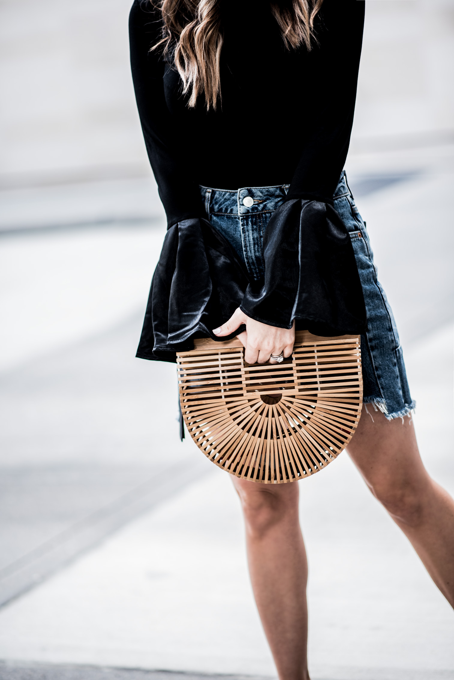 Houston fashion and lifestyle blogger Tiffany Jais wearing a denim skirt from Topshop and a bell sleeve top | Outfit ideas for spring, cult gaia, summer streetstyle
