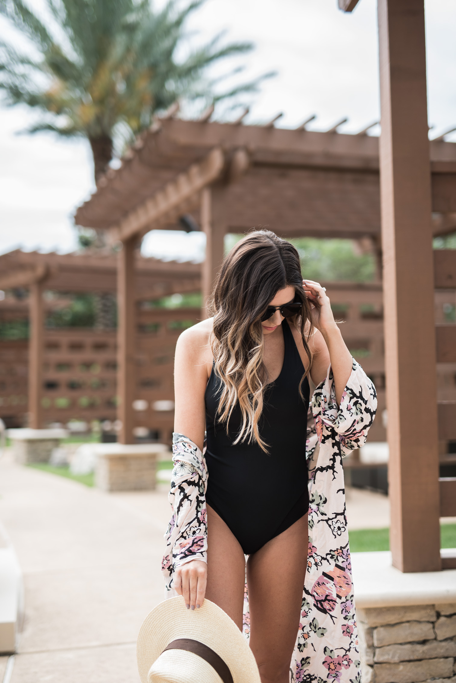 Tiffany Jais Houston fashion and lifestyle blogger   Black one piece suit, floral cover up, pool outfit ides, free people,