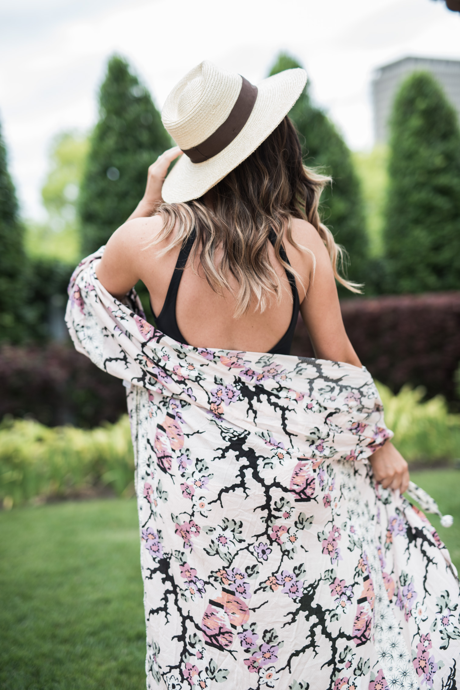 Tiffany Jais Houston fashion and lifestyle blogger | Black one piece swimsuit, floral cover up, pool outfit ides, free people,