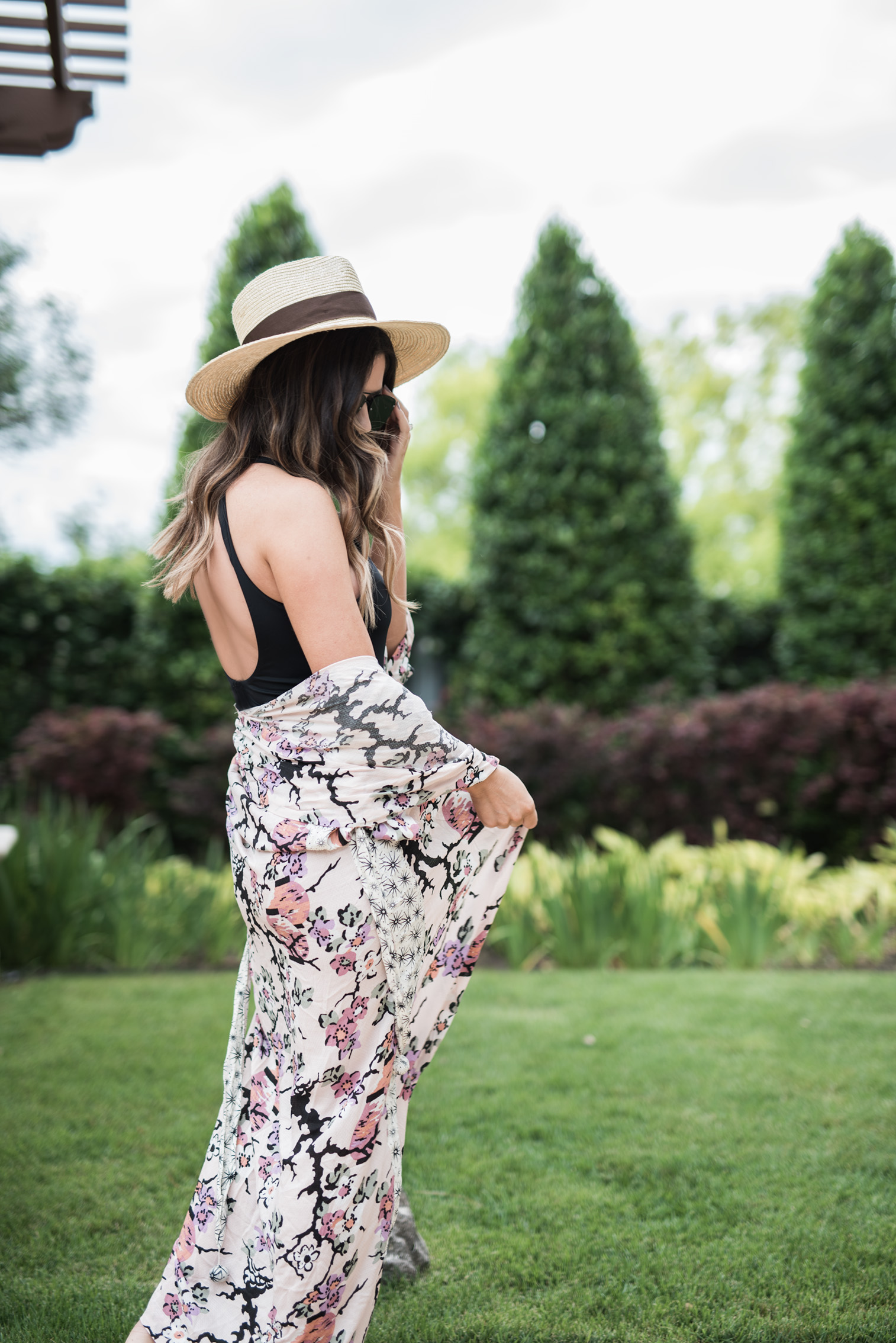 Tiffany Jais Houston fashion and lifestyle blogger   Black one piece swimsuit, floral cover up, pool outfit ides, free people,