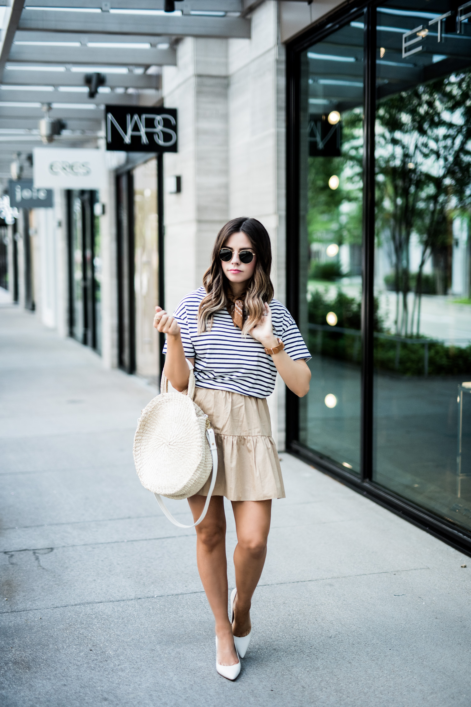 Tiffany Jais Houston fashion and lifestyle blogger | circle straw tote, ruffle hem skirt, casual summer outfits, street style 2017, white block heels, bandana outfits