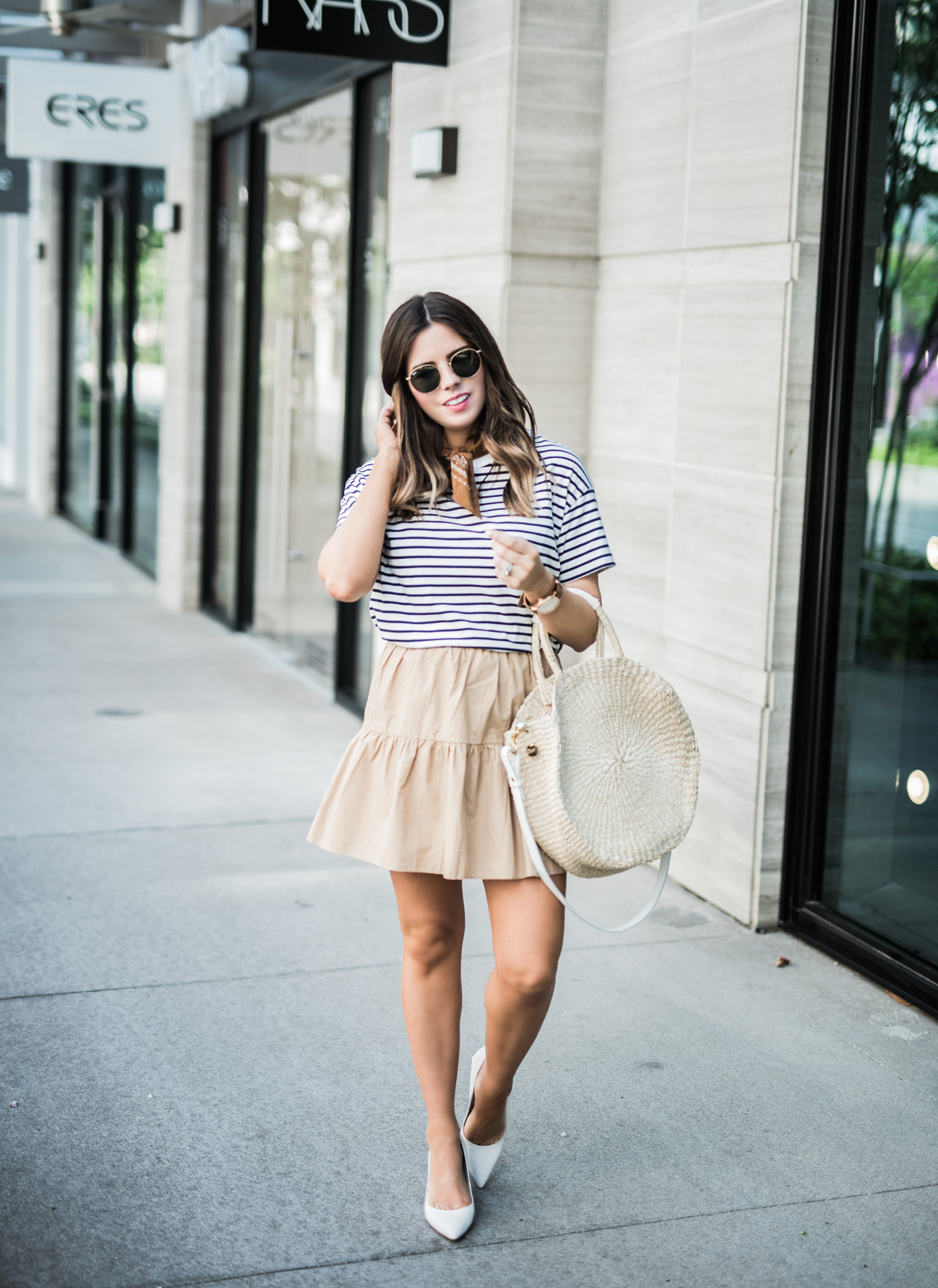 Tiffany Jais Houston fashion and lifestyle blogger | 20 skirts that will step up your summer wardrobe | circle straw tote, ruffle hem skirt, casual summer outfits, street style 2017, white block heels, bandana outfits