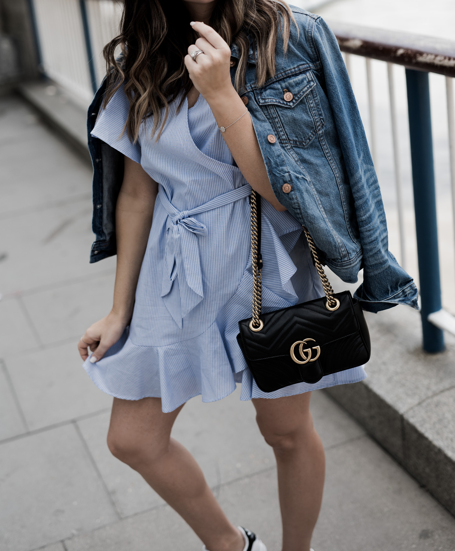 Tiffany Jais Houston fashion and lifestyle blogger | The London eye-what I wore, Gucci marmot bag, wrap dress, dresses with sneakers outfits, casual outfits, what to wear in London, Things to do in London