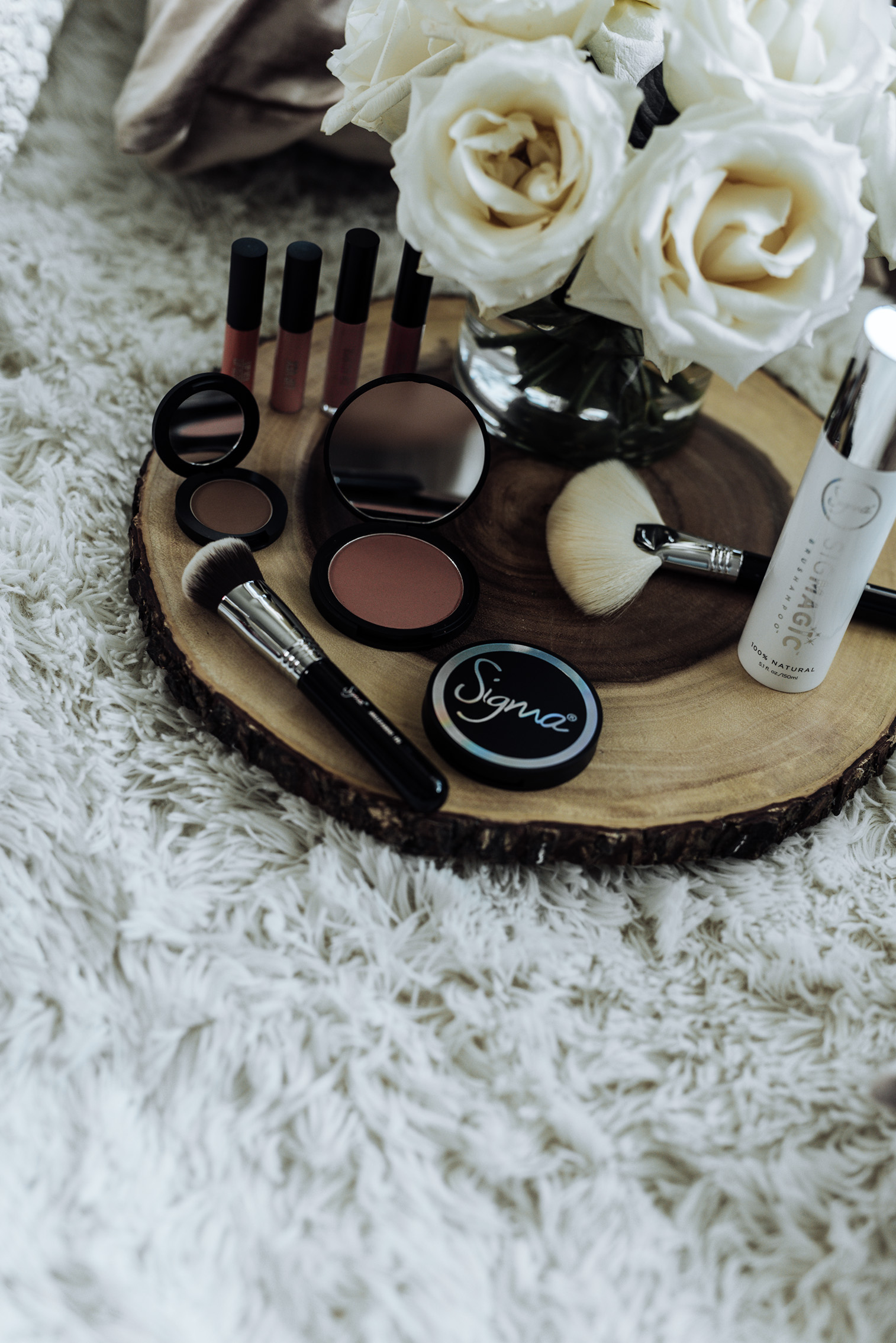 Tiffany Jais fashion and lifestyle blogger of Flaunt and Center | Beauty blogger | Sigma Beauty Poweder bronzer-LIMELIGHT | Aura Powder blush in Cor-De-Rosa | Fan Brush | Brow expert kit | Sigma Spa brush cleaning glove | SIGMAJIC Brush shampoo | Lip Eclipse set in Neutral
