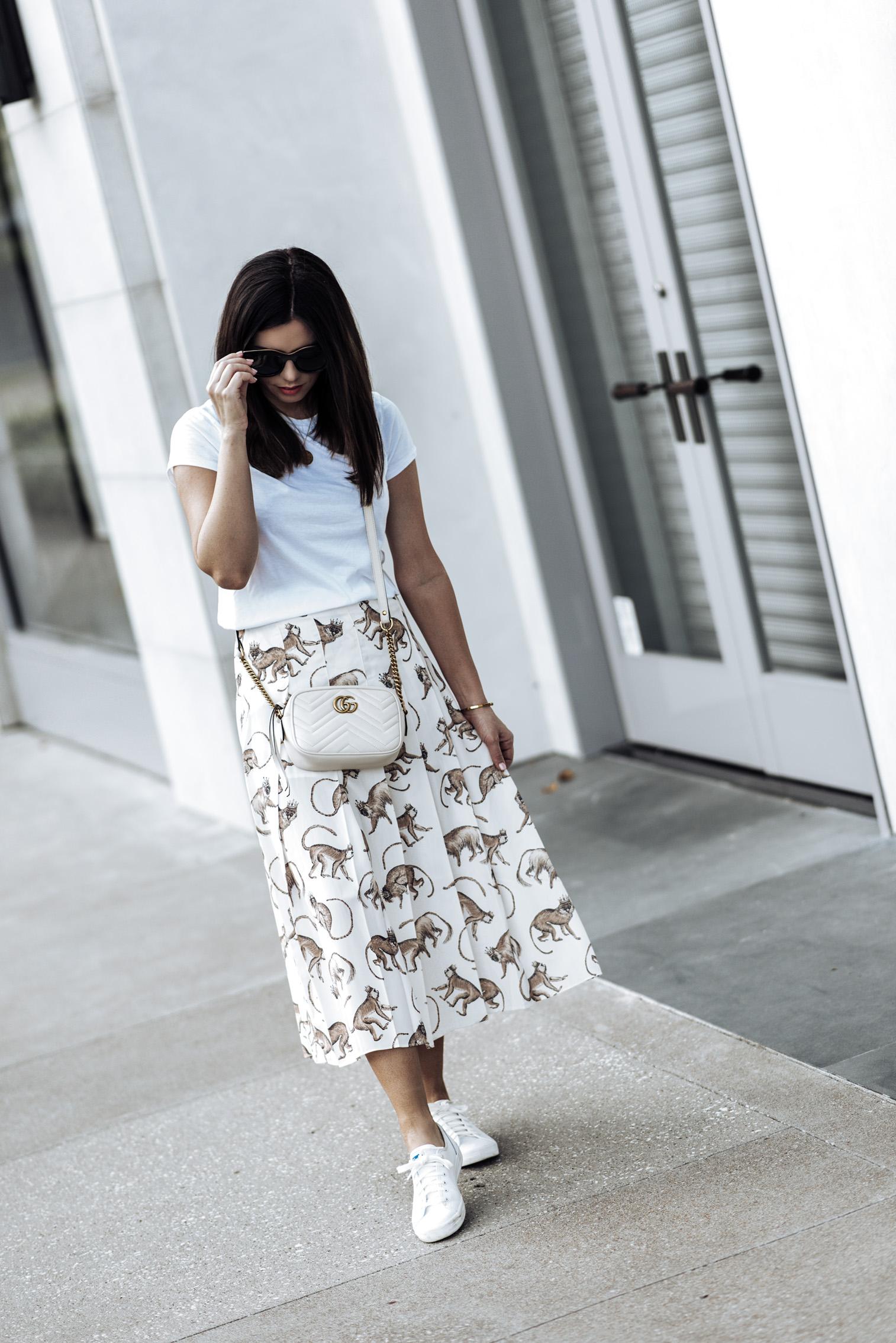 Tiffany Jais fashion and lifestyle blogger of Flaunt and Center | Monkey Print | Houston fashion blogger | Printed monkey skirt H&M | White Cotton Tee | Keds Kickstart leather sneaker | Gucci Marmont in white