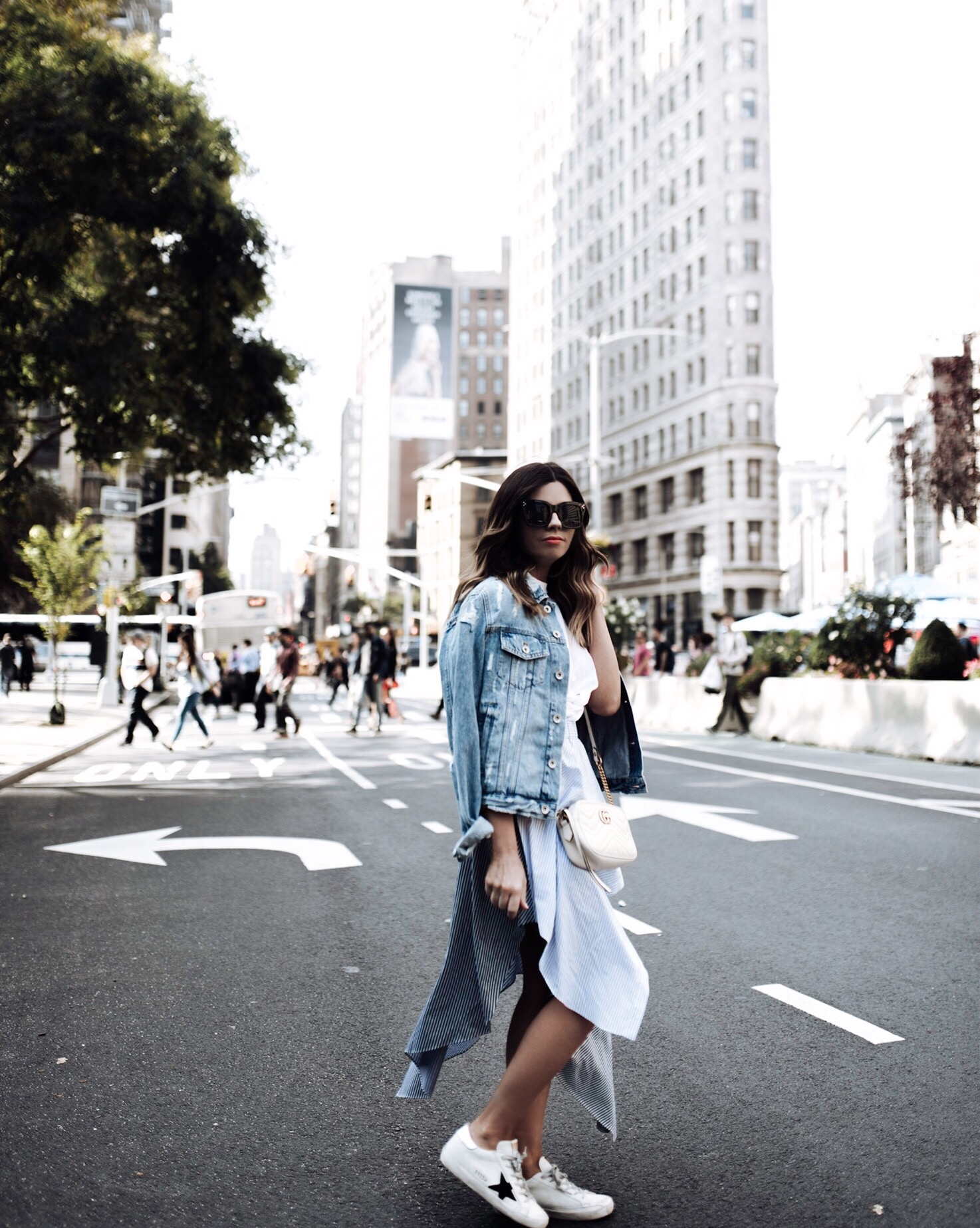 Tiffany Jais fashion and lifestyle blogger of Flaunt and Center | NYFW | Flat iron building NYC | Opening Ceremony skirt, Gucci marmot bag in white