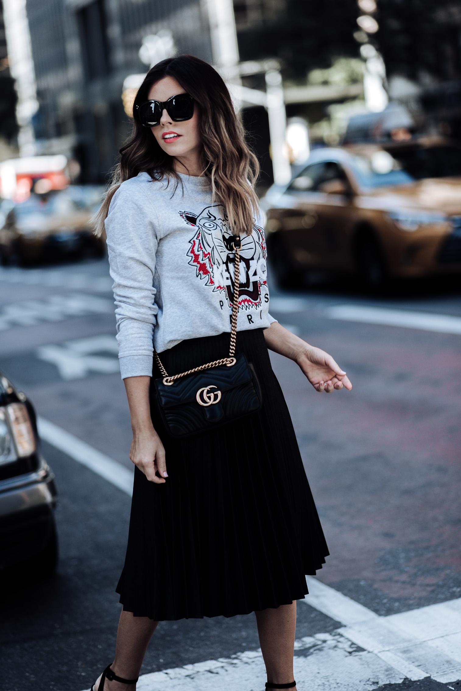Tiffany Jais fashion and lifestyle blogger of Flaunt and Center | Houston fashion blogger | NYFW day 2 outfit | Streetstyle blog Pleated skirt | Kenzo Sweatshirt | Platform heels | Gucci Marmont Bag