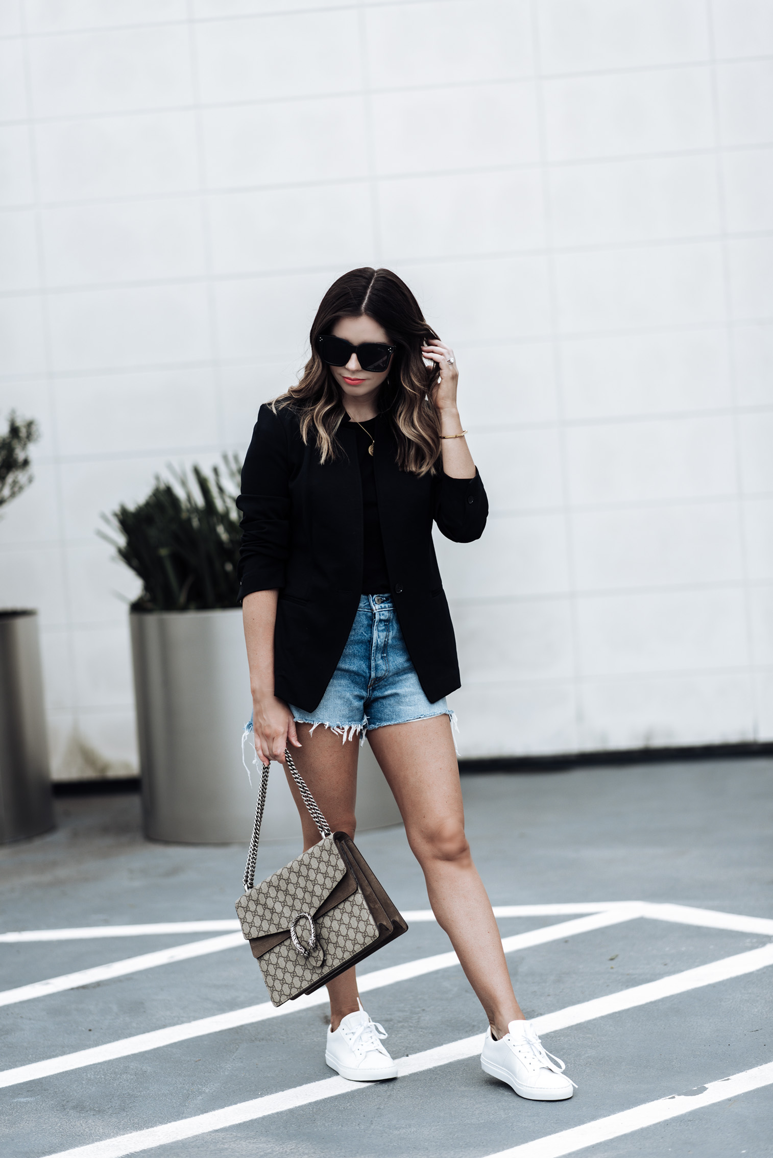 Tiffany Jais Houston fashion and lifestyle blogger | Fall must have pieces with Banana Republic, click to shop the look | Sneaker fashion, Longline Blazer | Basic Black Tee | Greats sneakers | Gucci Dionysus bag | Parker Distressed Denim Shorts | Marie Pendant