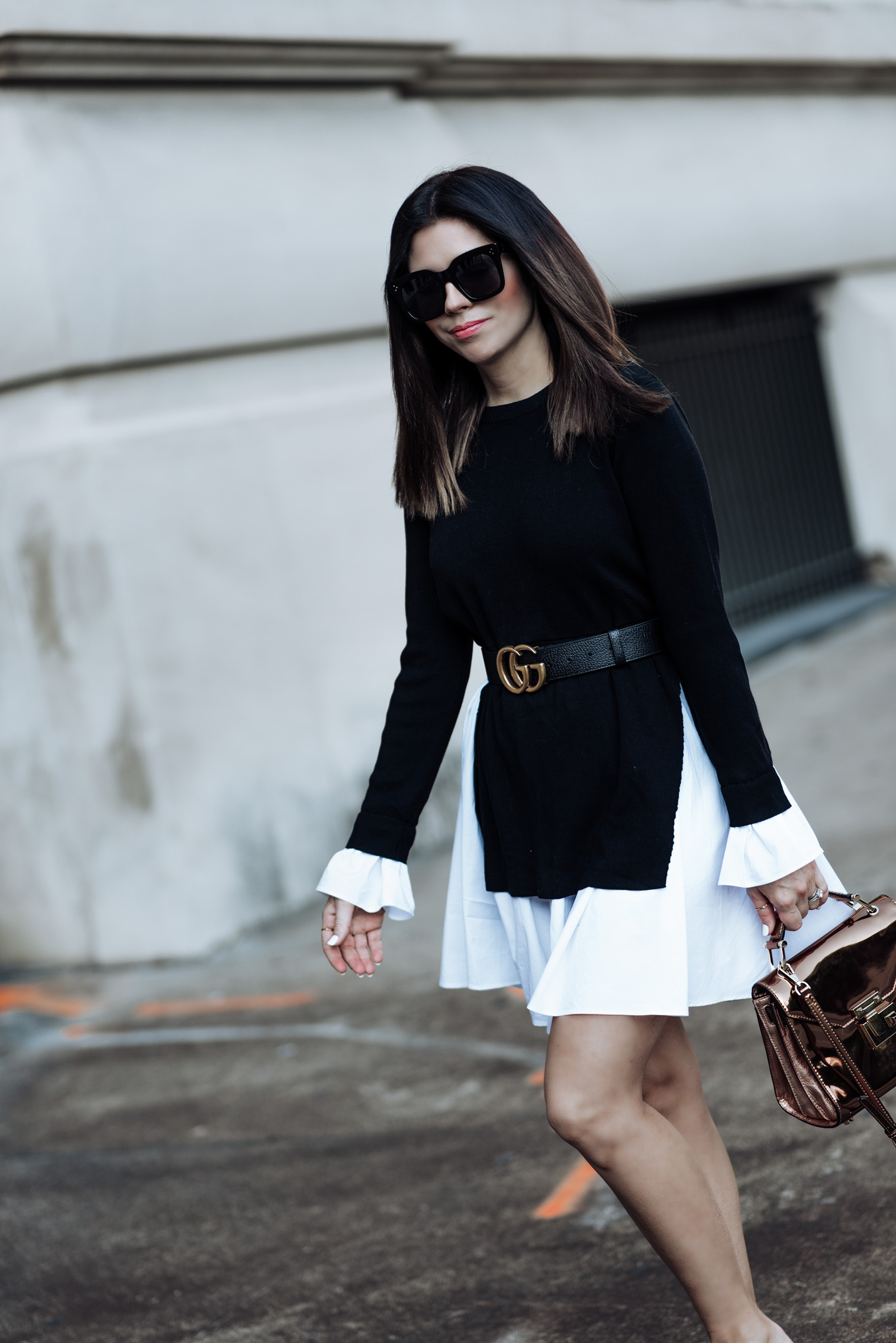 Click to shop the look. Houston fashion and style blogger | Black and white styles | English Factory Knit Combo Dress (Similar style here) | Rebecca Minkoff Mini Paris Crossbody | Similar Black Mule Slides| Gucci Double G belt (men's pebbled leather) |