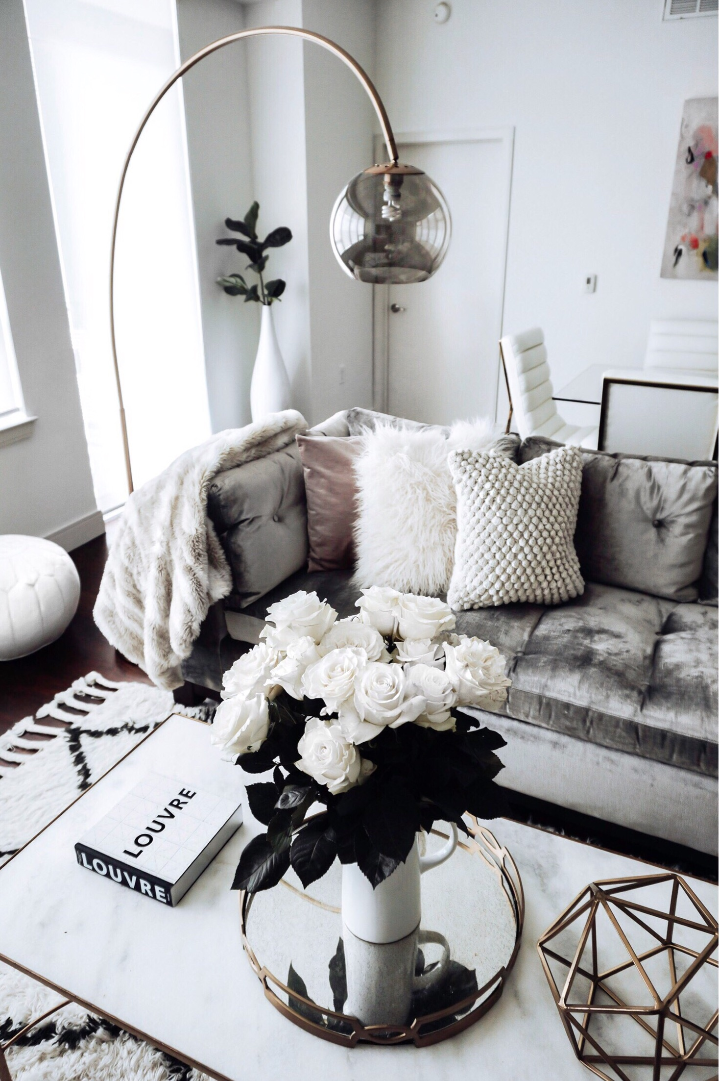 Friday feels |Finally getting back into the swing of posting more home decor! I'm excited to start planning holiday content and will be sure to get that out a little early to give you guys plenty of inspiration! White pitcher |home decor blog | Scandinavian interiors | Pillows here, here, and here | Lamp | Rug | white leather pouf