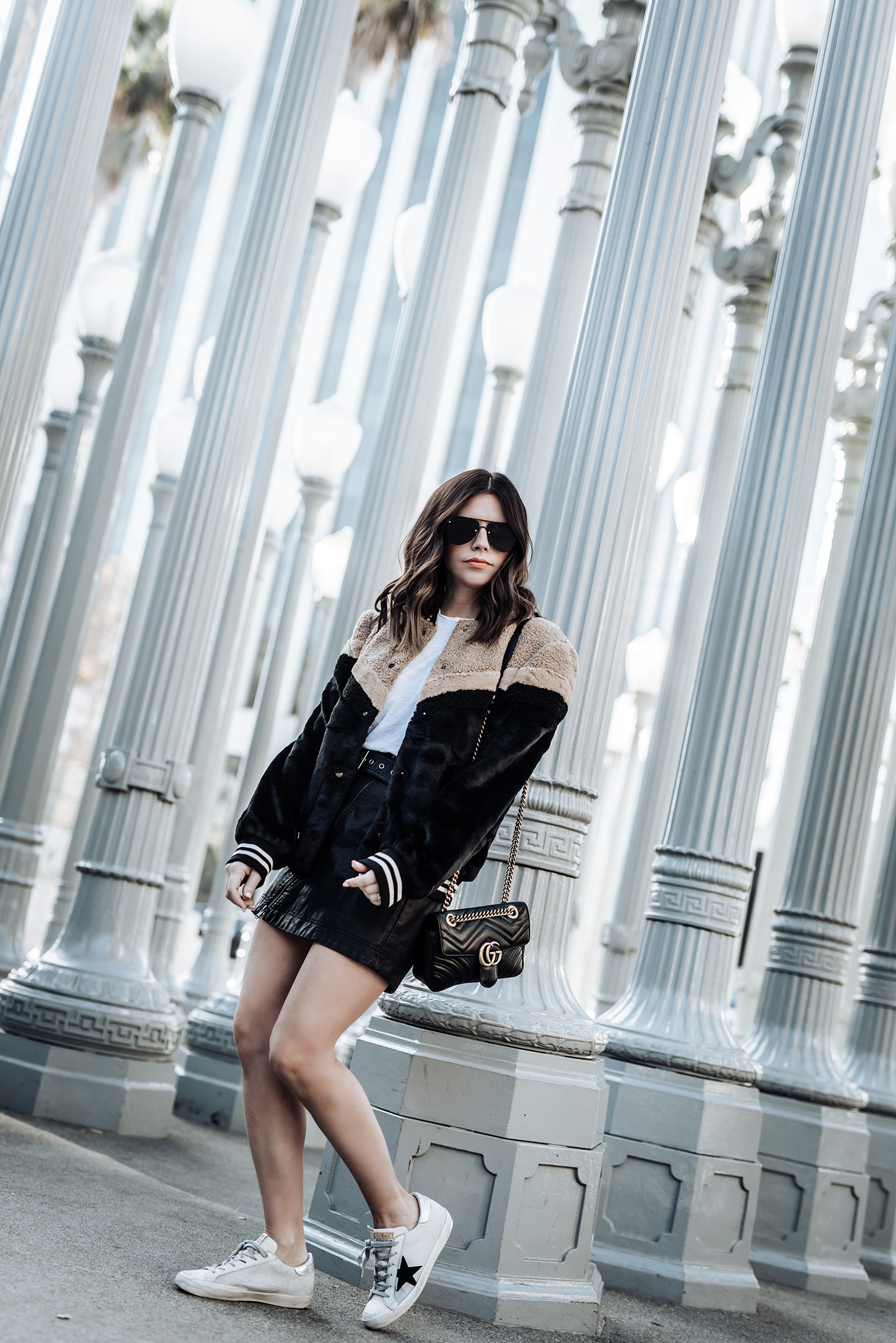 Faux fur bomber (Lord & Taylor) | Free People Feeing Fresh vegan leather skirt | Golden Goose Superstar Sneakers| Gucci Bag | Faux fur bomber | skirt |