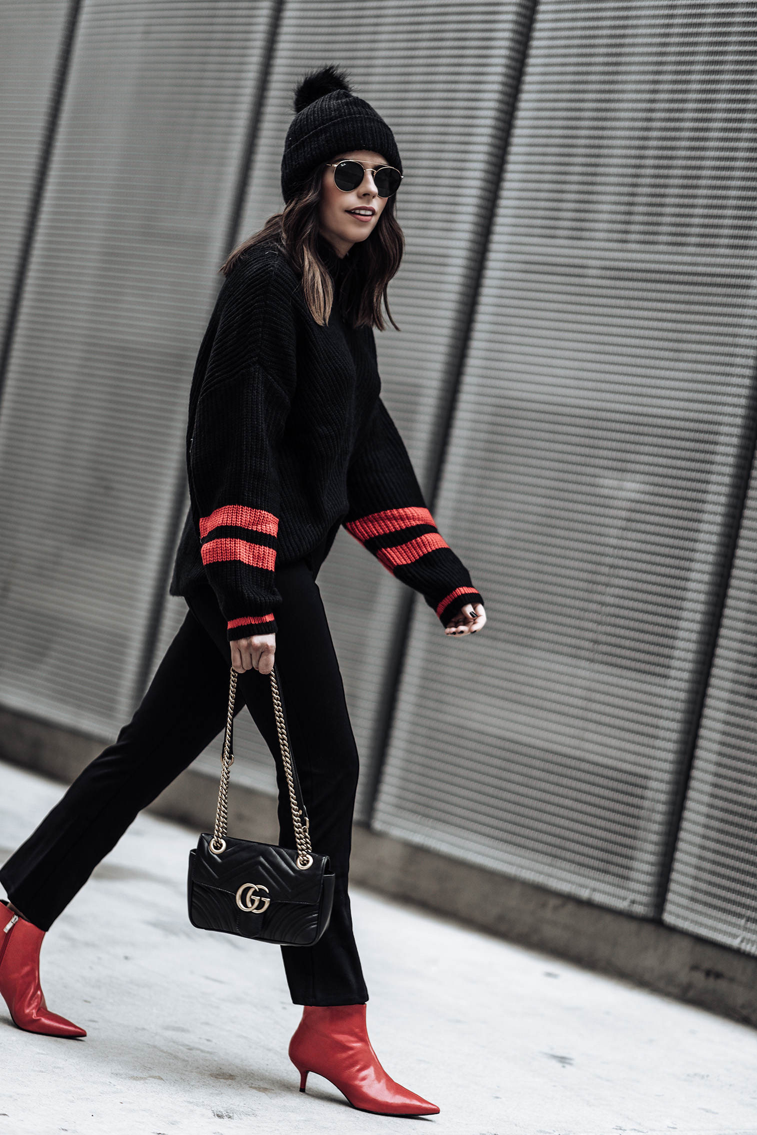 Power color - Striped sleeve sweater | Happy Trails faux fur pom pom beanie | Red point toe ankle boots (Zara, similar here) | Mini Gigi Marmot Bag | Lovers + Friends Crop Flare Pant | 51 MM Aviator Sunglasses | #streetstyle