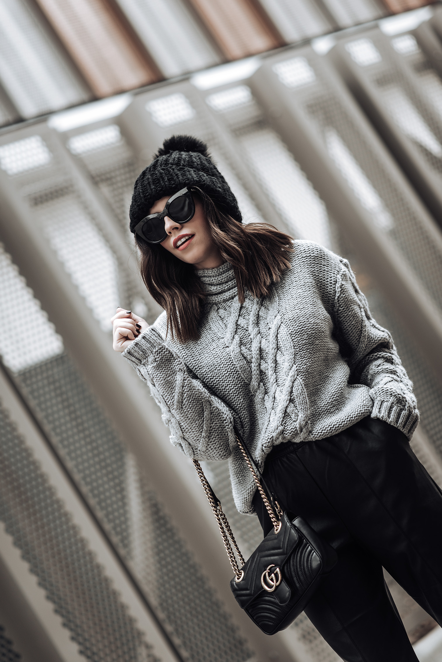 Tiffany Jais fashion and lifestyle blogger of Flaunt and Center | Houston fashion blogger | Leather joggers | Streetstyle blog | Grey chunky knit sweater (similar) | Leather pant | Mini GG Marmot bag | Oversized chunky knit beanie (sold out similar here) #streetstyle #blog #chunkysweater