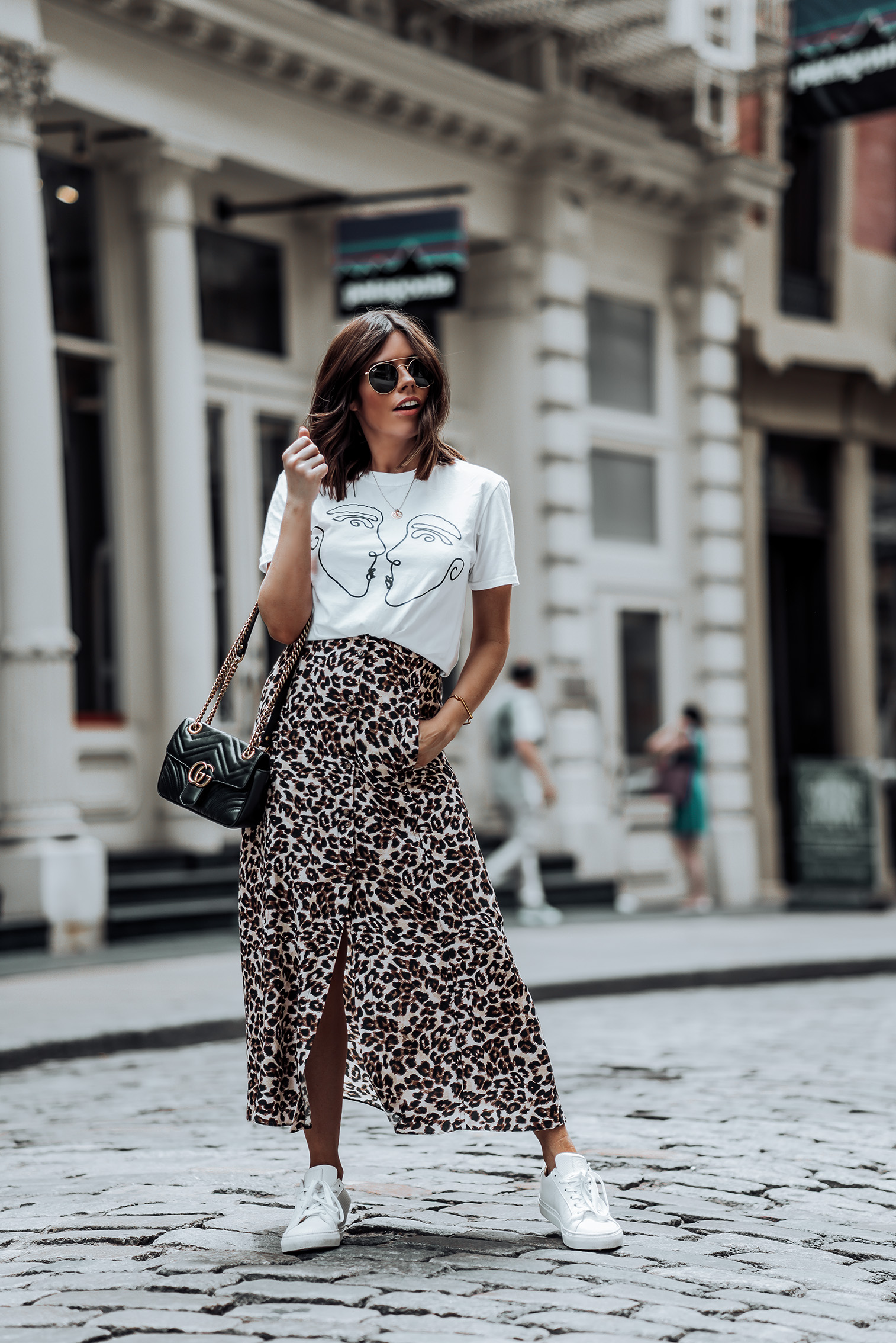 Leopard is the new black |Graphic Tee | Urban Outfitters Leopard Skirt | Gucci Bag | Greats Sneakers | #liketkit #leopard #minimalist #sneakeroutfits #streetstyle