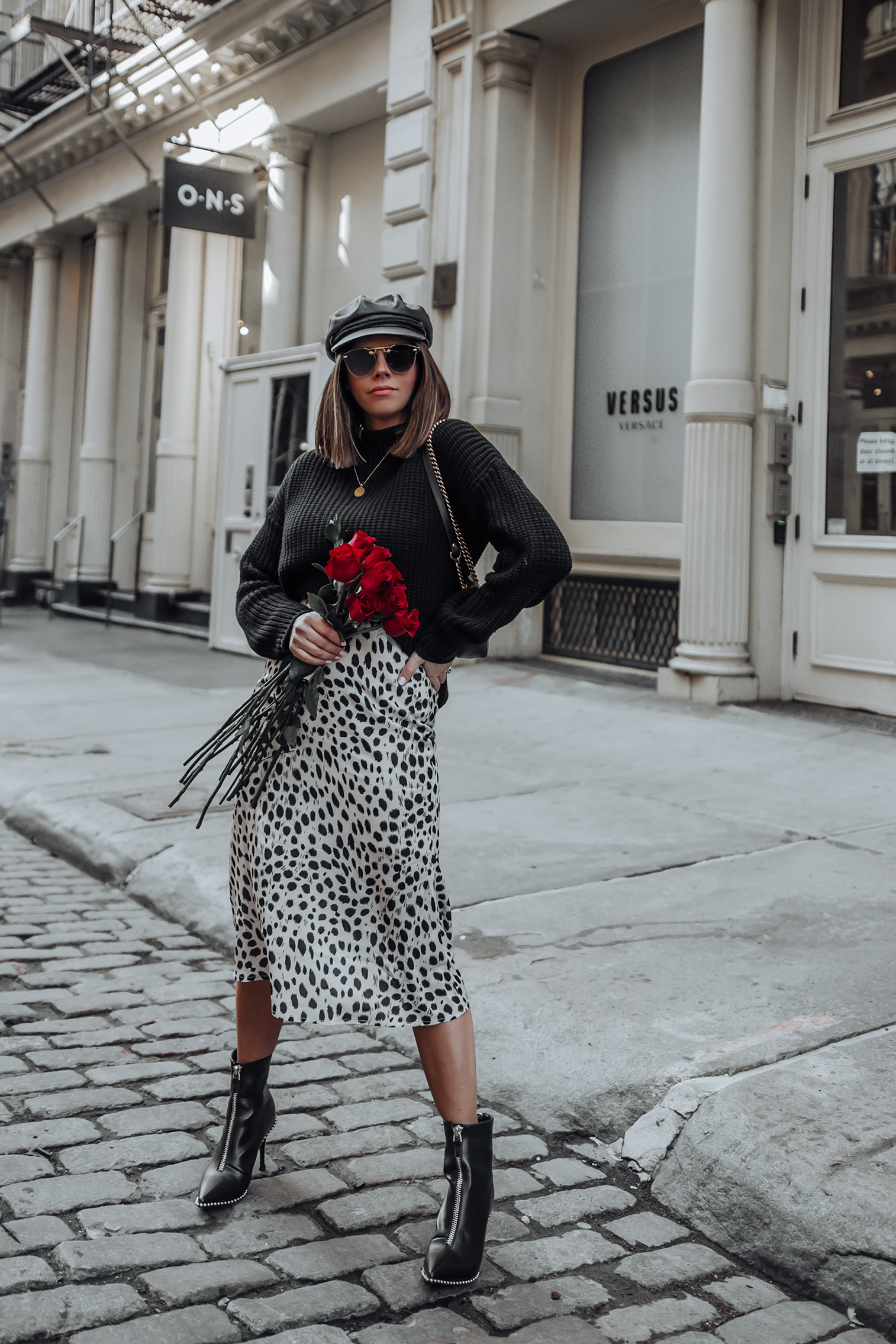 Cheetah spot skirt | Booties | Gucci Bag | Sweater Happy hump day babes! I shot this look on Valentine's Day last week and I'm so excited to finally share it here on the blog! This spot print skirt is seriously so flattering and flirty I felt it was the perfect look for Valentines. We didn't really do anything to celebrate since we have a newborn at home, but it's still fun to get dressed up!