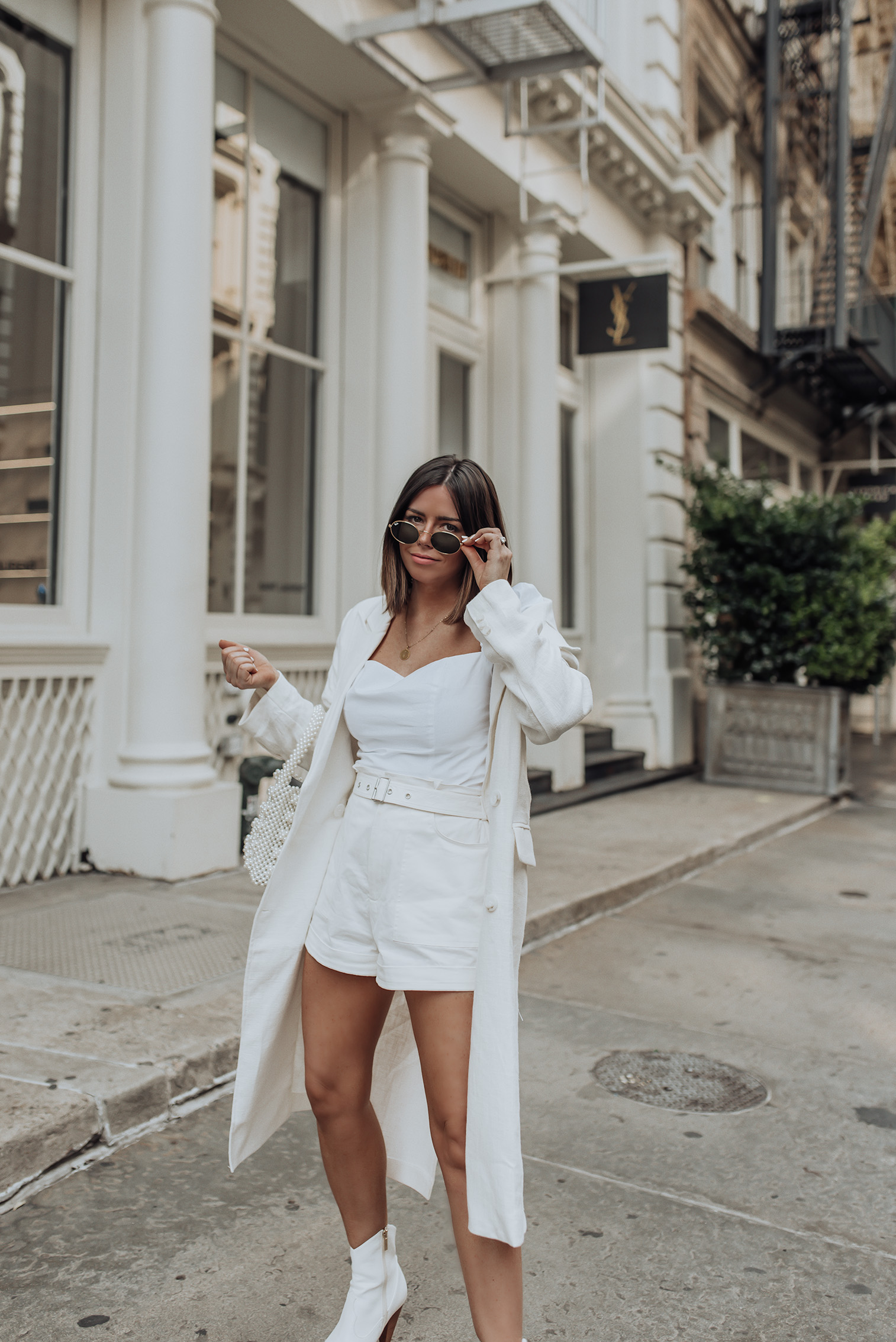 Happy Thursday babes! Gosh this week just flew by! I feel like time goes even faster once you become a mom because the multitasking all day long is super real. Haha! But I wouldn't trade the madness for anything!  Anyway I'm super stoked to share this layered in white look with you guys today! I'm obsessed with white right now and the temps dropped a tiny bit so I was able to sneak in an extra layer. Insert this white linen trench, the perfect summer layer since linen is so breathable! #streetstyleblog