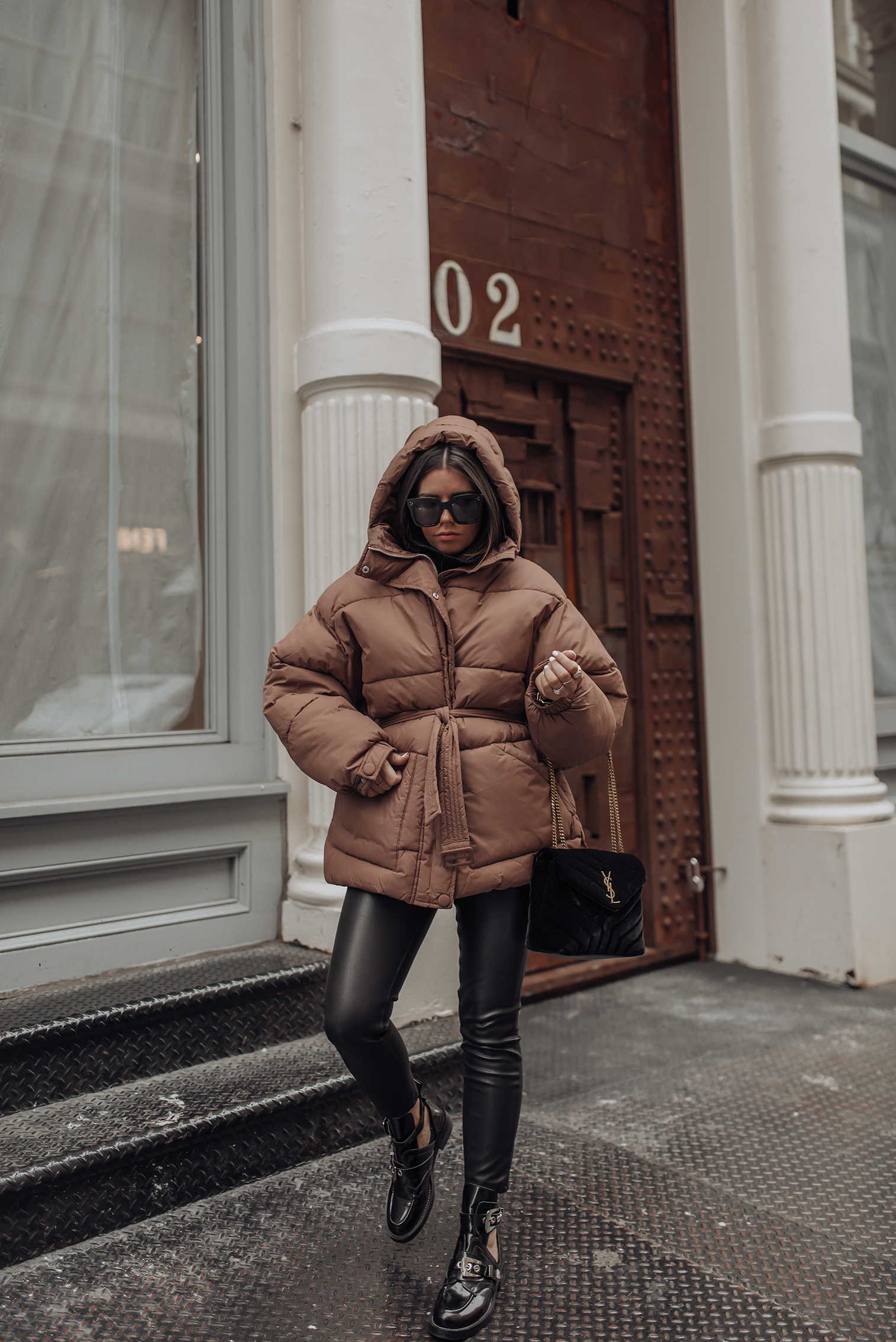 Oversized Puffer Coat   Faux Leather Pants   Buckle boots (Similar)    Winter is coming. No but really, it's getting very chilly. Instead of hibernating, I found this super fab oversized puffer coat from Nellycom that packs some major heat. It's definitely made for the super chilly days. I made the mistake a few weeks ago of wearing it out while in 50 degree weather and ended up removing because it was so warm. But it's getting great use in this 30 degree we are having in NYC at the moment! #streetstyle #puffercoat
