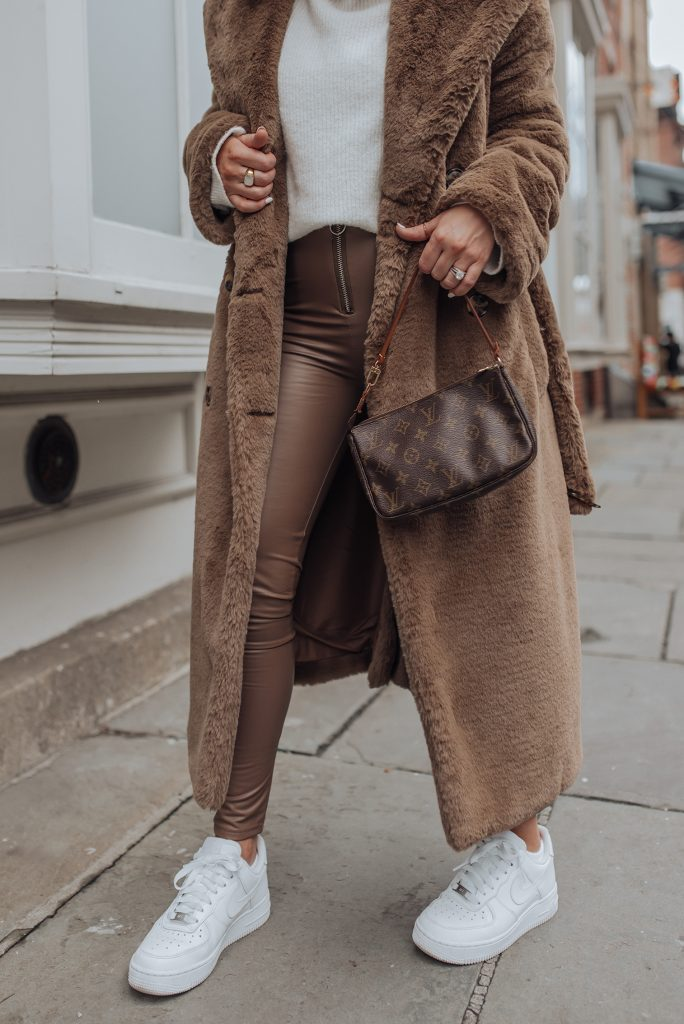 Coat (H&M, similar here) | Leggings | LV Pouch Bag | Beanie | Sneakers Happy Friday loves! So in love with brown tones this year. My IG feed can definitely contest to that as well, haha! Today's look is probably one of my all time favorites! There is just something so magical about pairing brown tones together, throw in some leather and I'm sold! Haha!